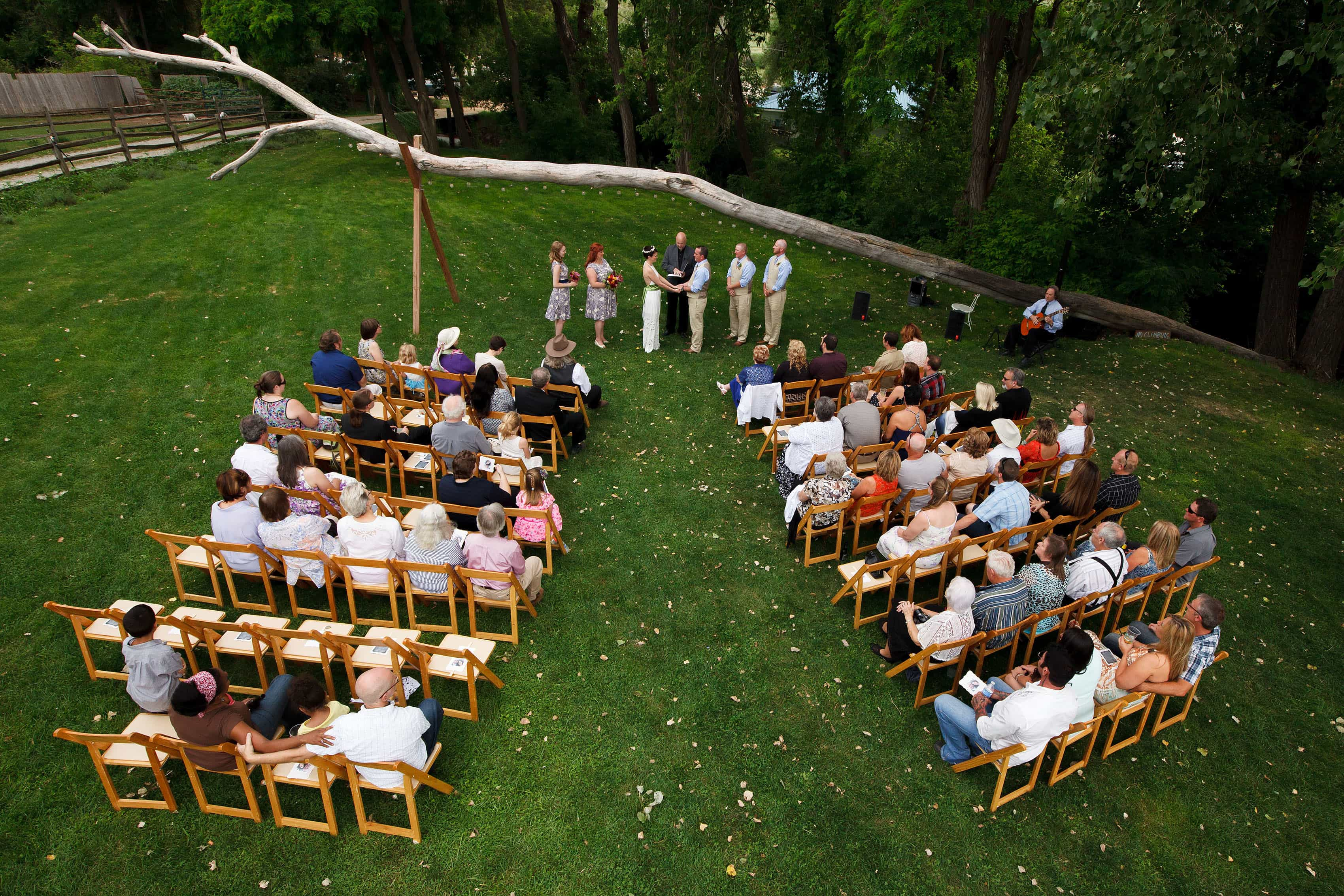 Outdoor Lyons Farmette wedding ceremony on the grass
