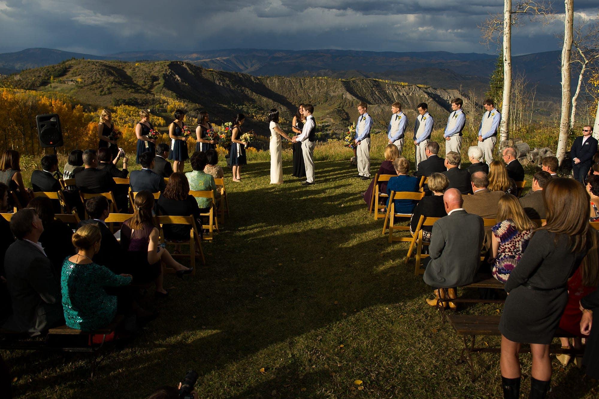 The sun illuminates Allison and Walker's Lynn Britt Cabin wedding in Snowmass Village near Aspen, Colorado.