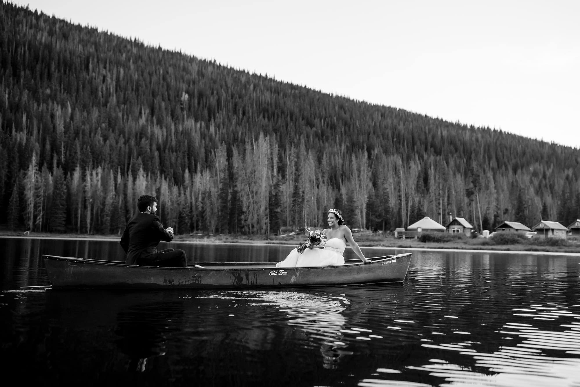 Becky and Brian row in a canoe on Piney Lake during their wedding in September outside of Vail, Colorado.