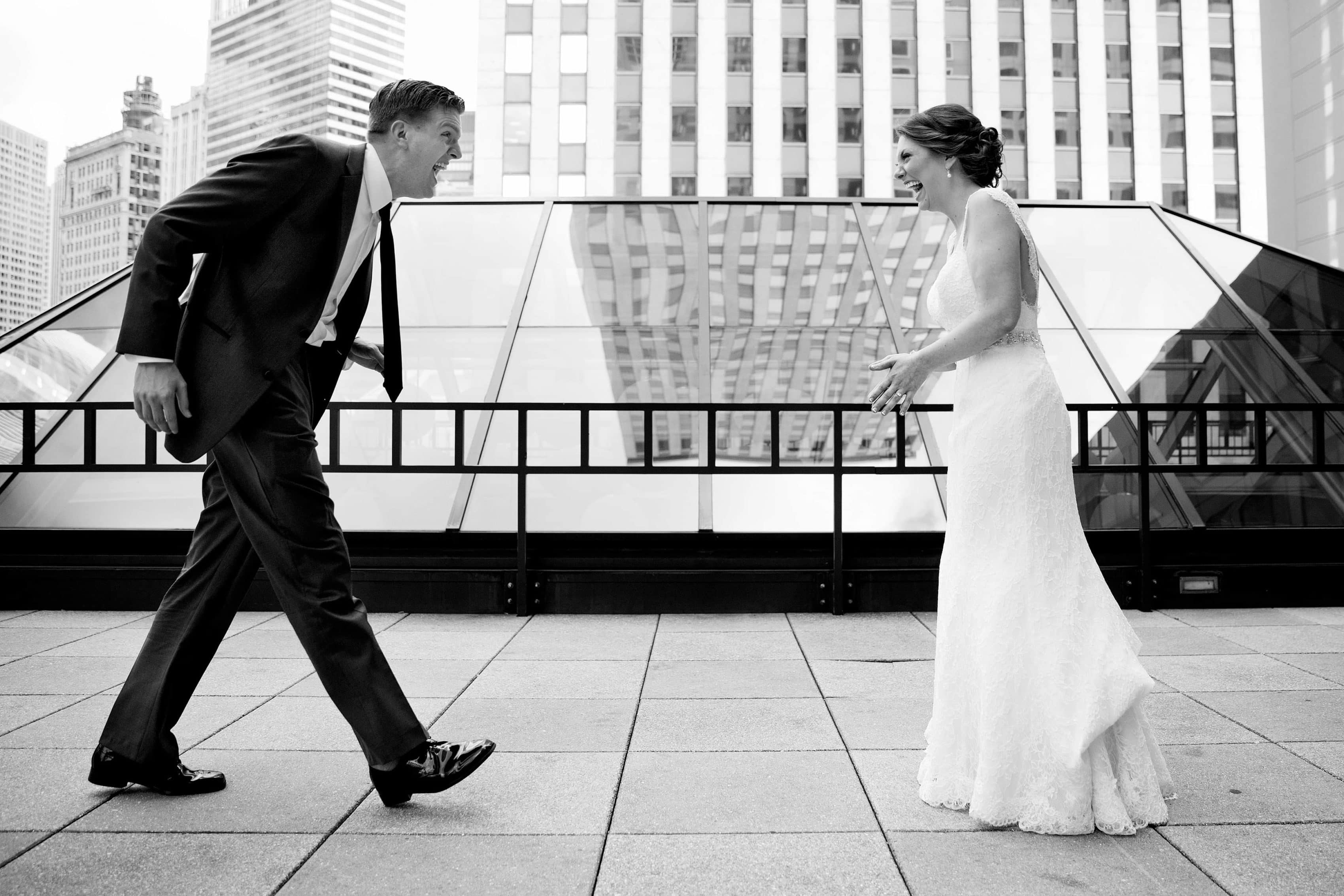 The bride and groom react to seeing each other during their first look before their wedding at the Ravenswood Billboard Factory in Chicago