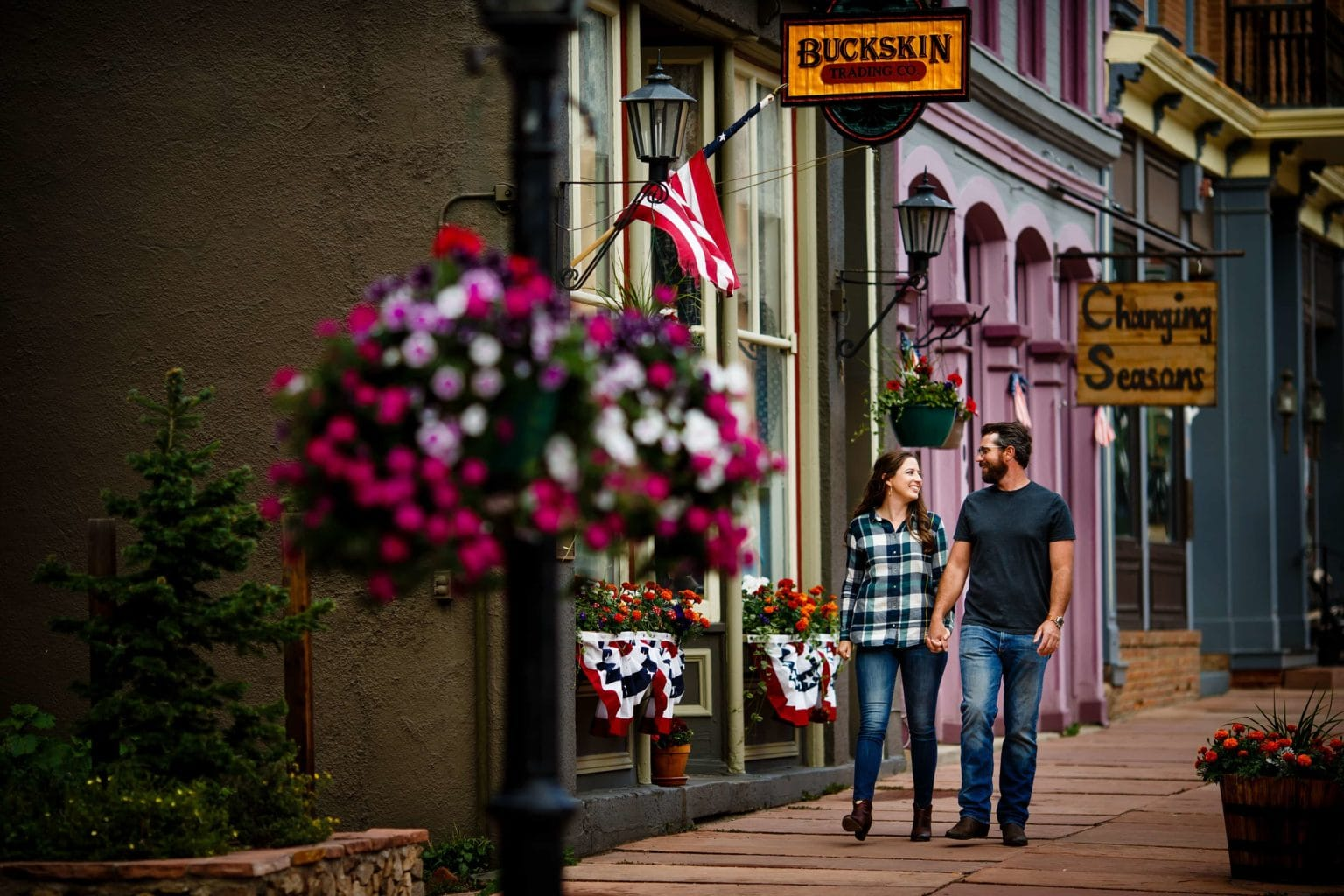 Mallory and Daniel walk down 6th street in Georgetown, Colorado in July.