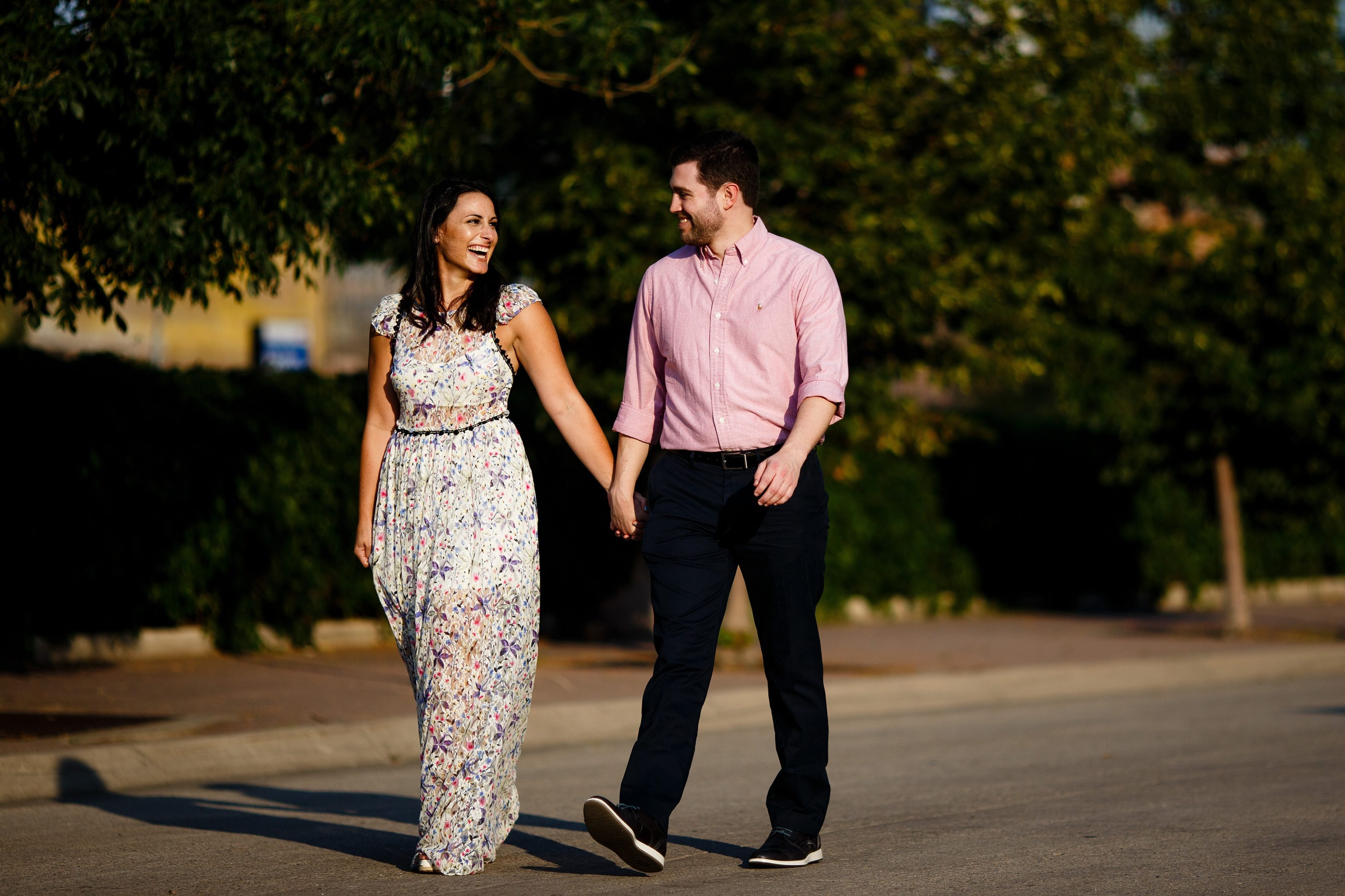 Danielle and Jordan walk together in lower downtown Denver during their engagement photos