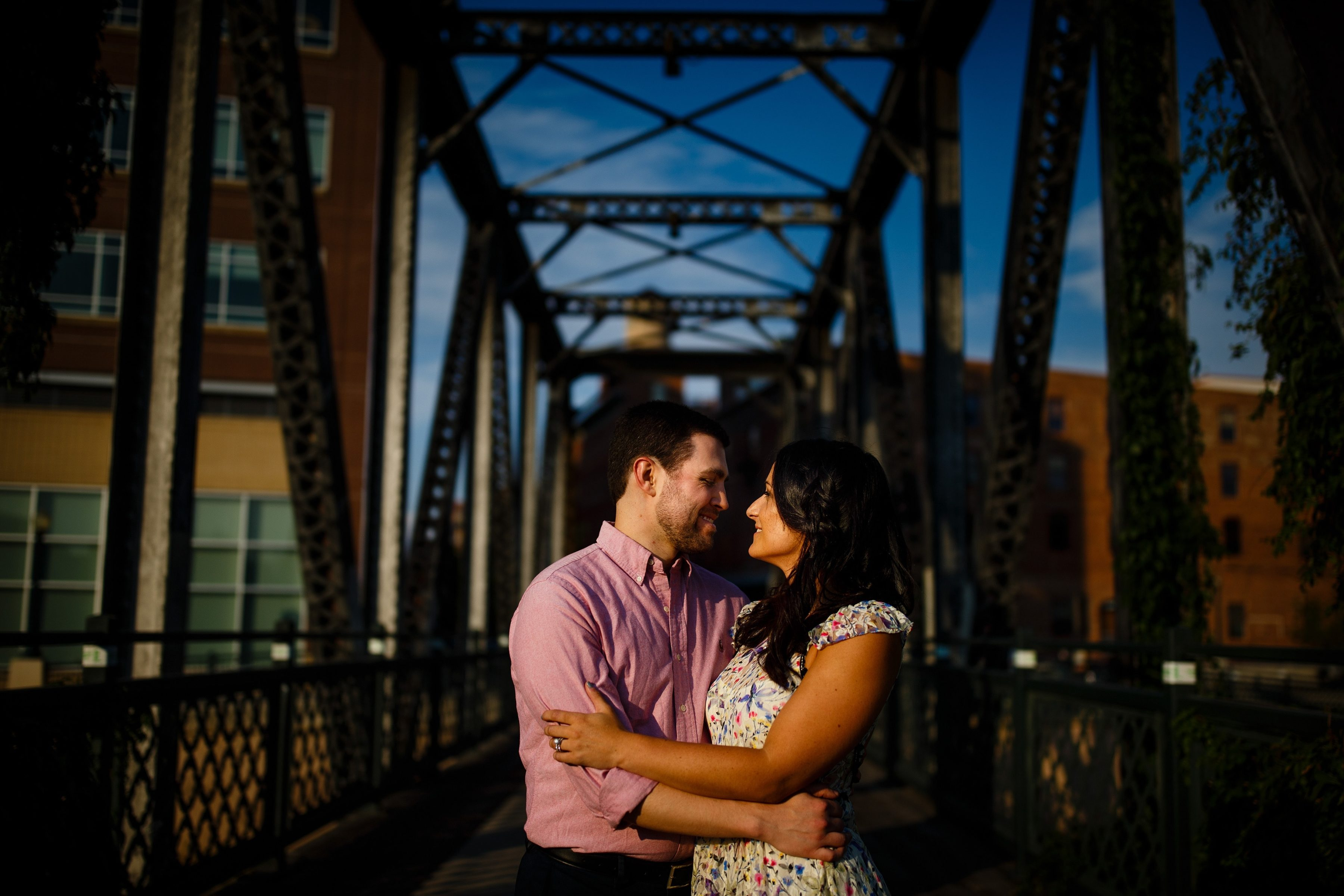 Jordan and Danielle hold each other on the Wynkoop bridge in the LoDo neighborhood during their engagement session