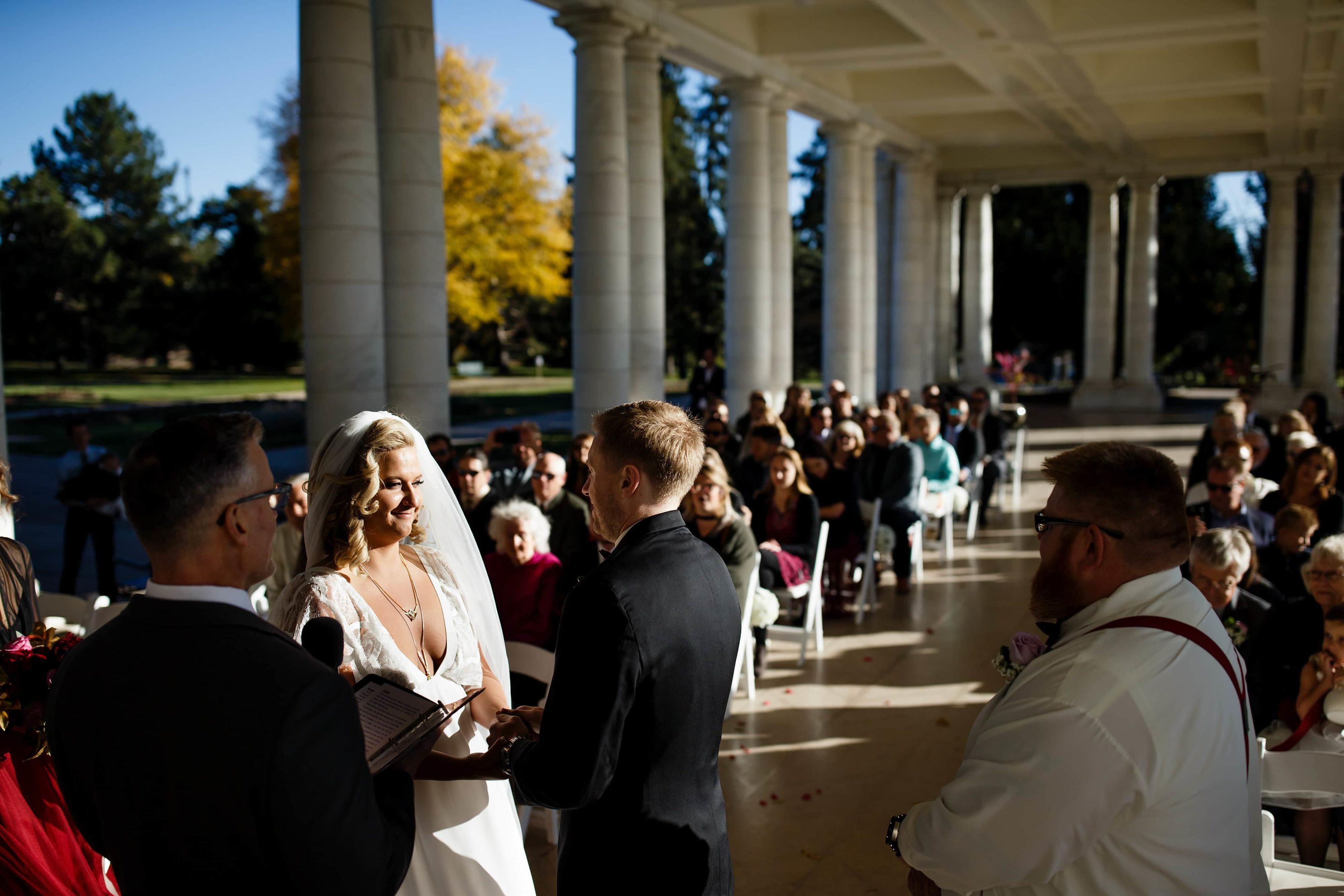 Sarah and Ryan stand under the pavillion during their Cheesman Park wedding