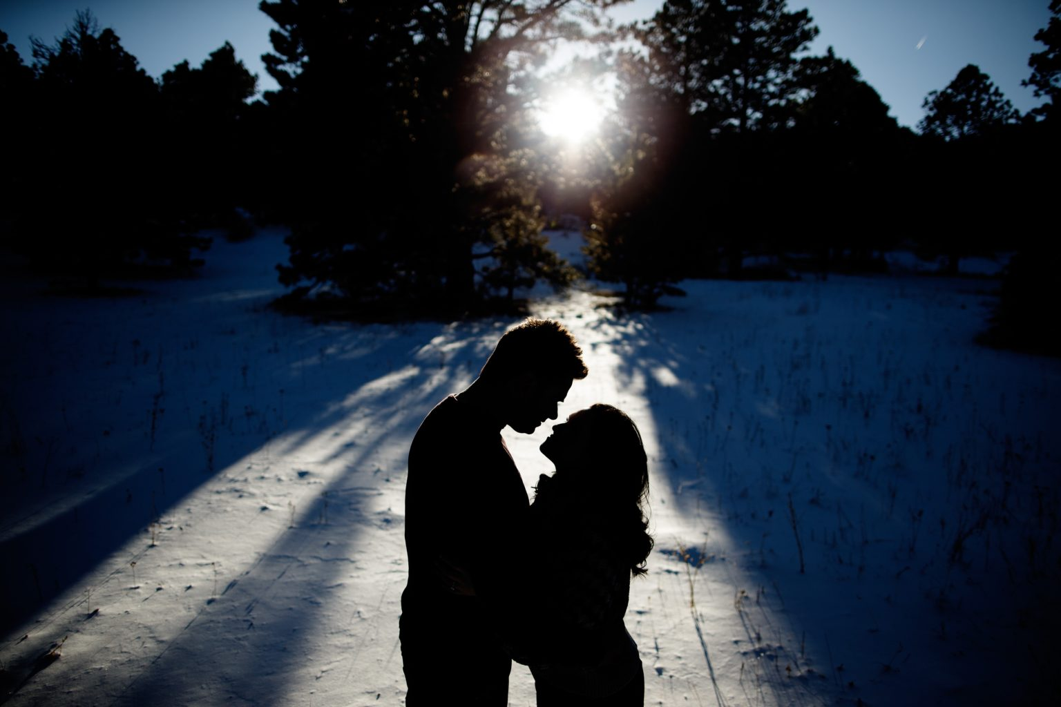 The sun casts shaddows in Elk Meadow Park as Melissa and Jordan pose together