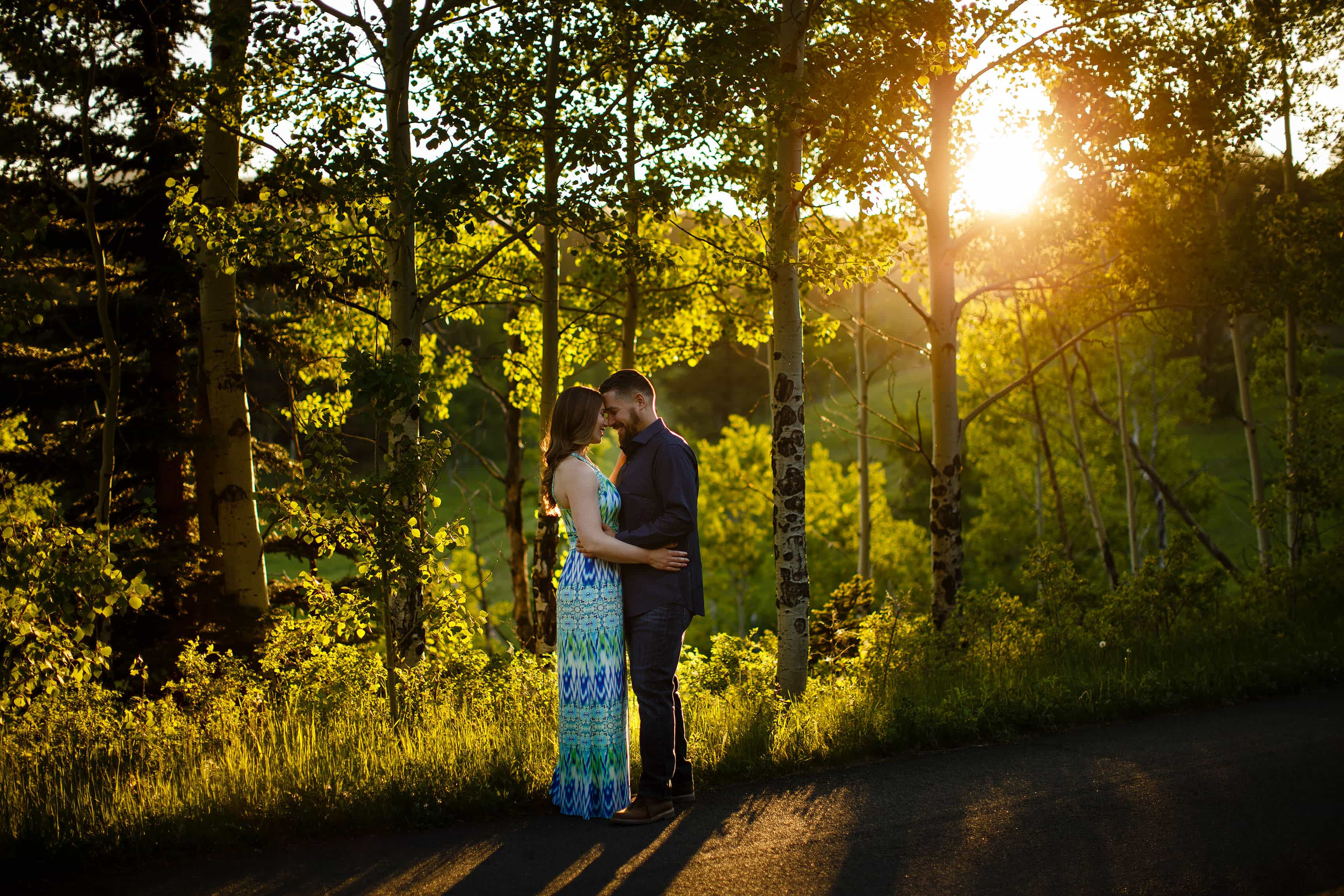 A couple embrace together for a moment as the sun set in Golden Gate Canyon State Park