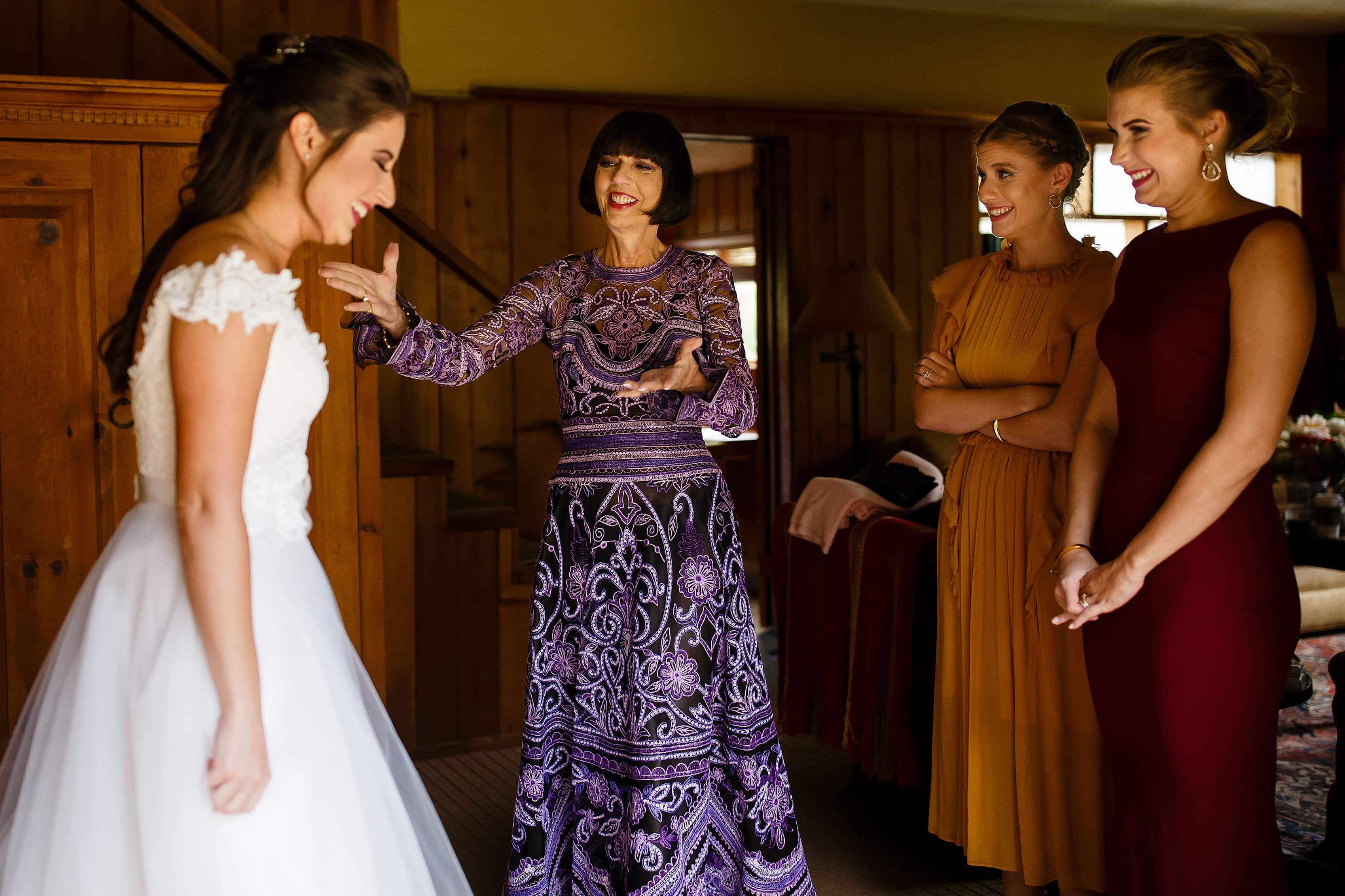 Mallory's mother and sisters react to seing her in her dress before the wedding at Snowmass Cottages near Aspen