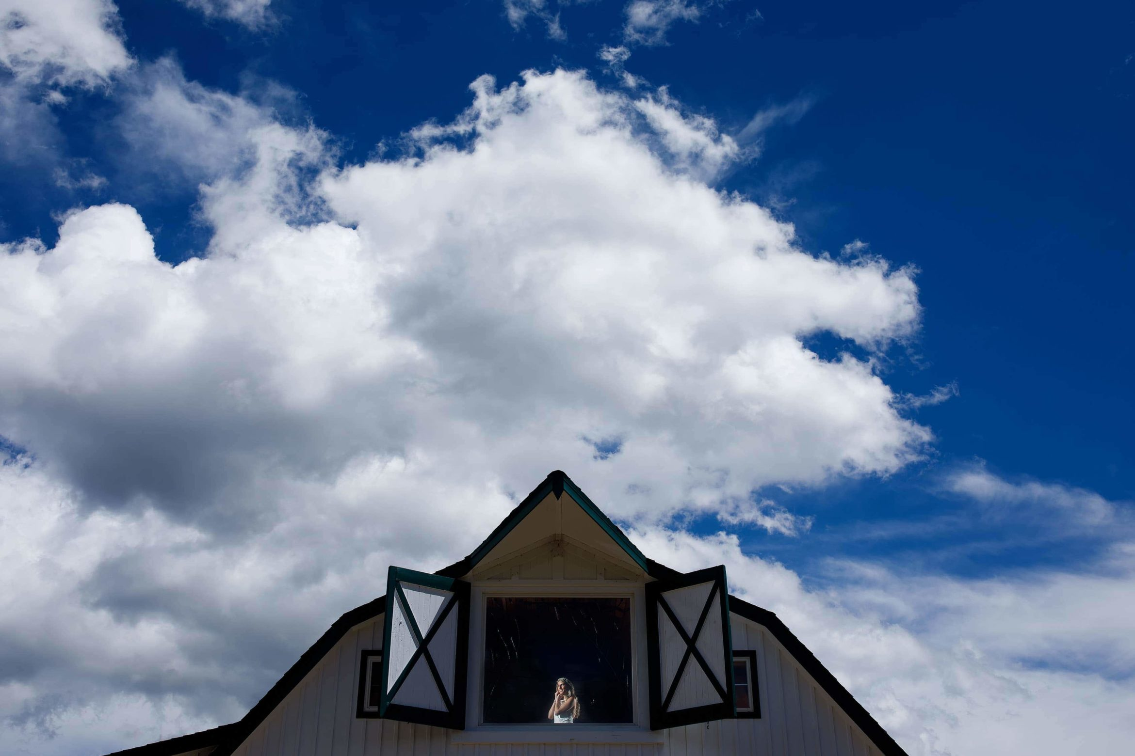 The bride gets ready in the barn at Deer Creek Valley Ranch