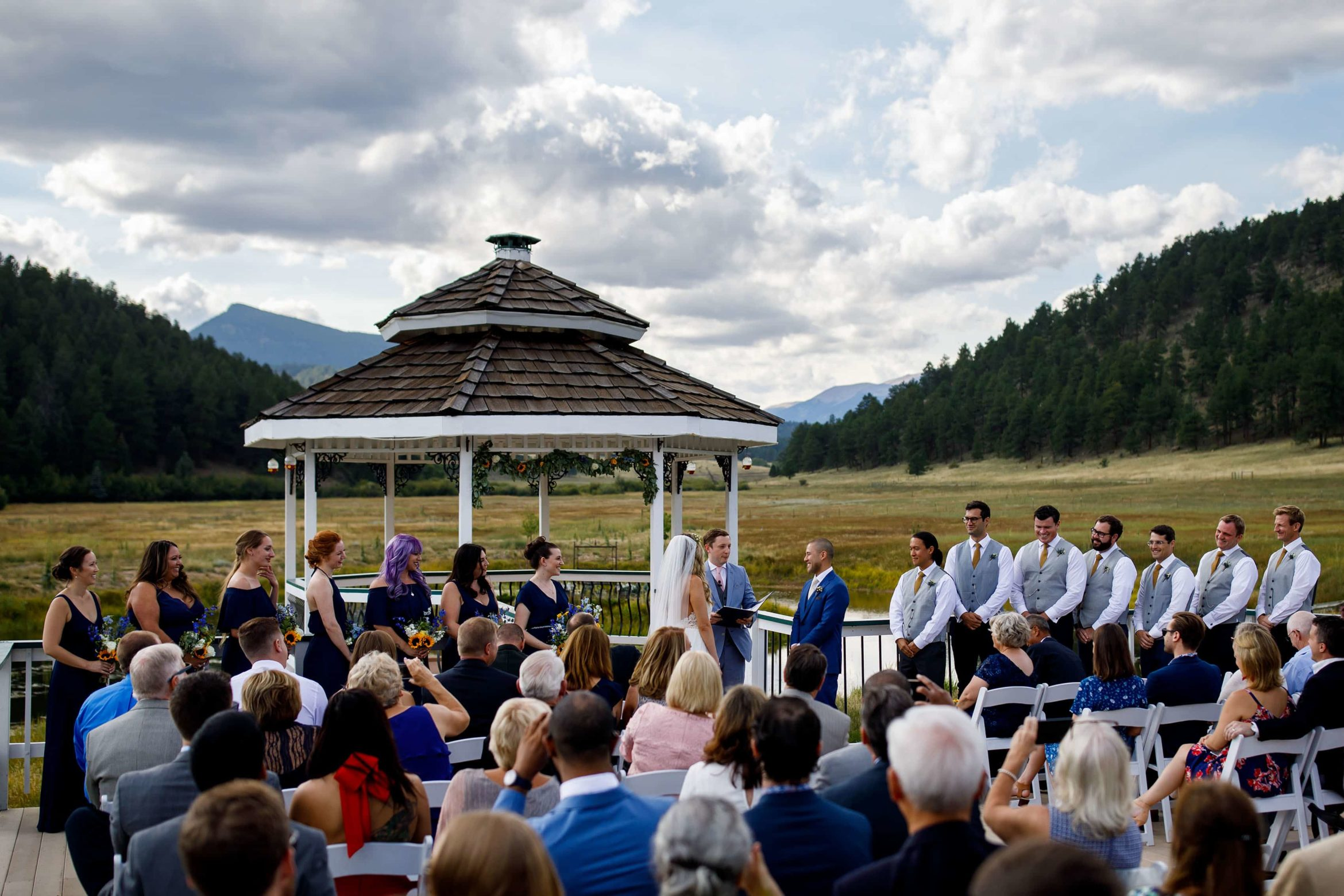 The ceremony takes place at the gazebo during a summer wedding at Deer Creek Valley Ranch