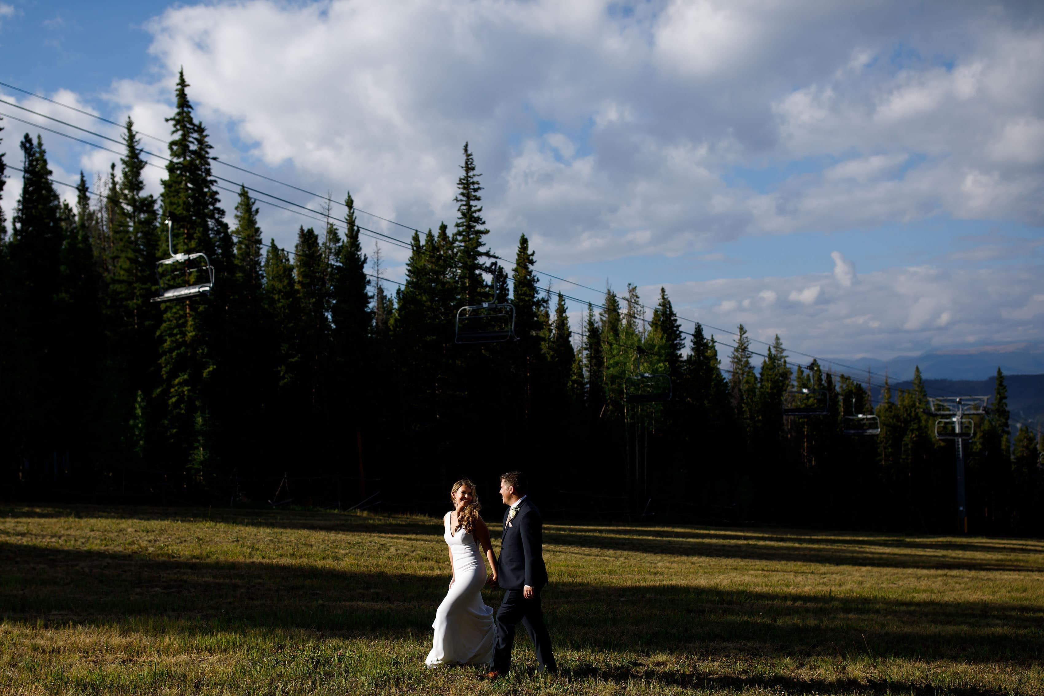 Heather and Matt walk together under the lift at TenMile Station