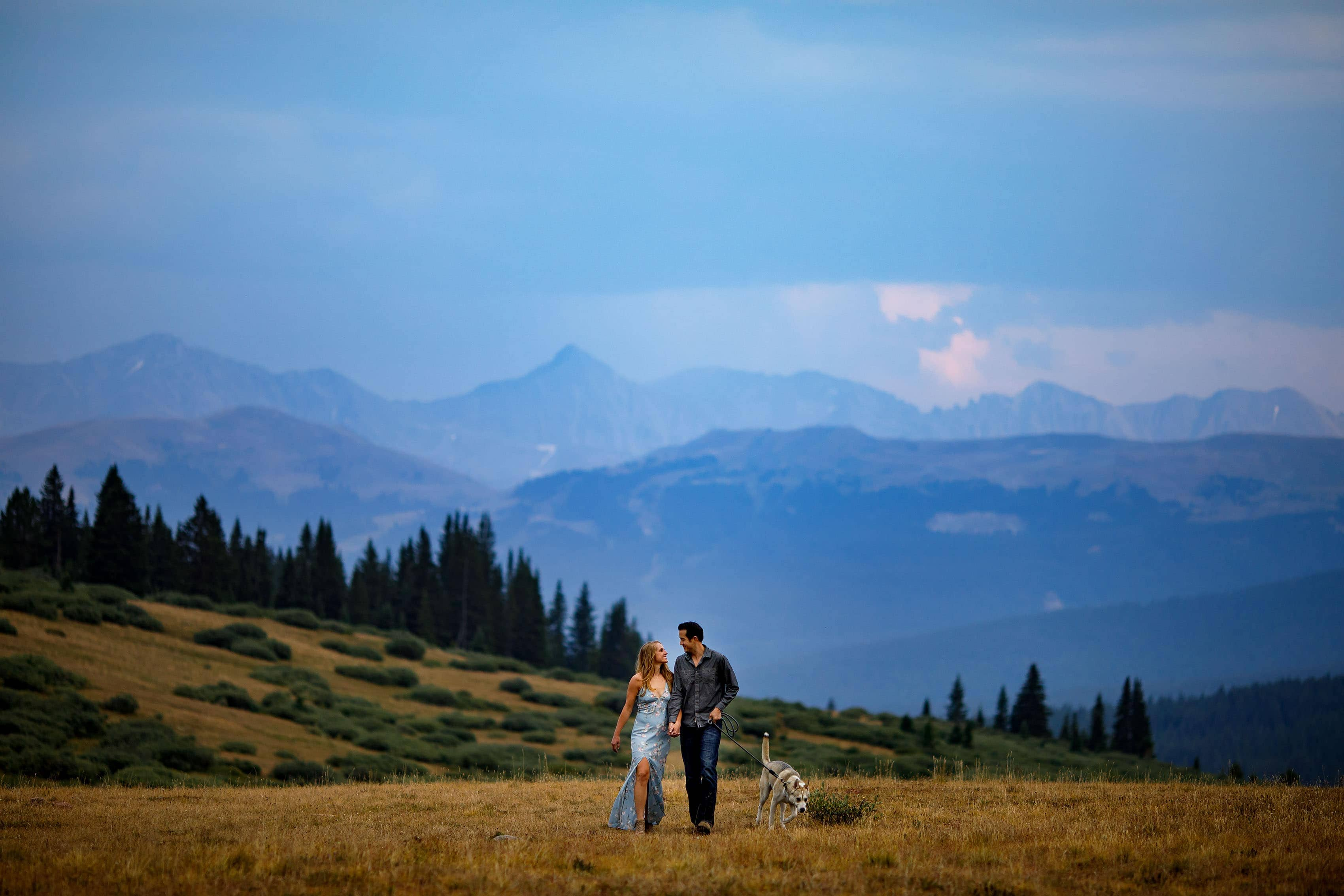 A couple walk with their dog during their Shrine Pass engagement photos