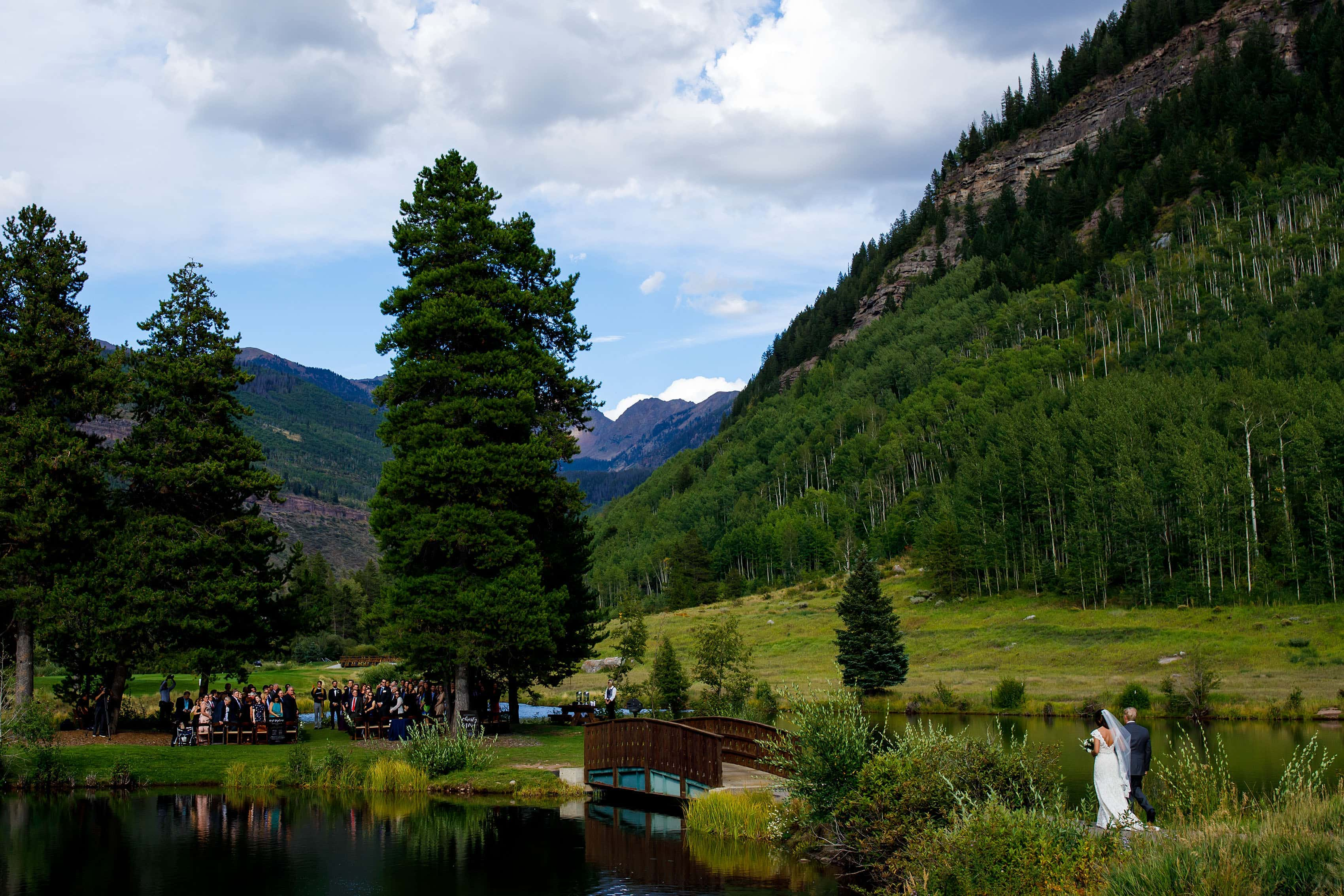 The bride walks across the bride during her Vail Golf Club wedding