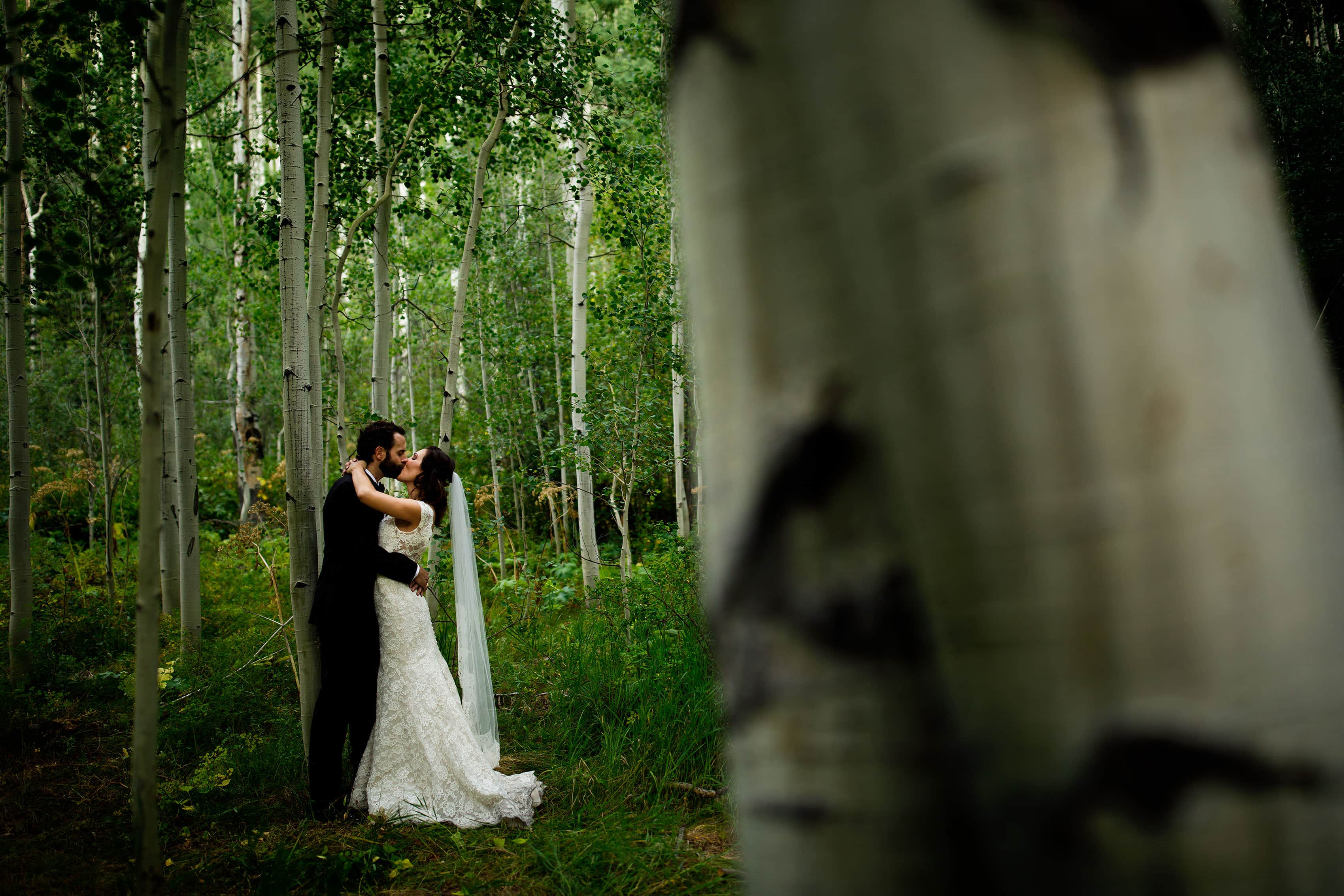 The couple share a kiss after their wedding in Vail