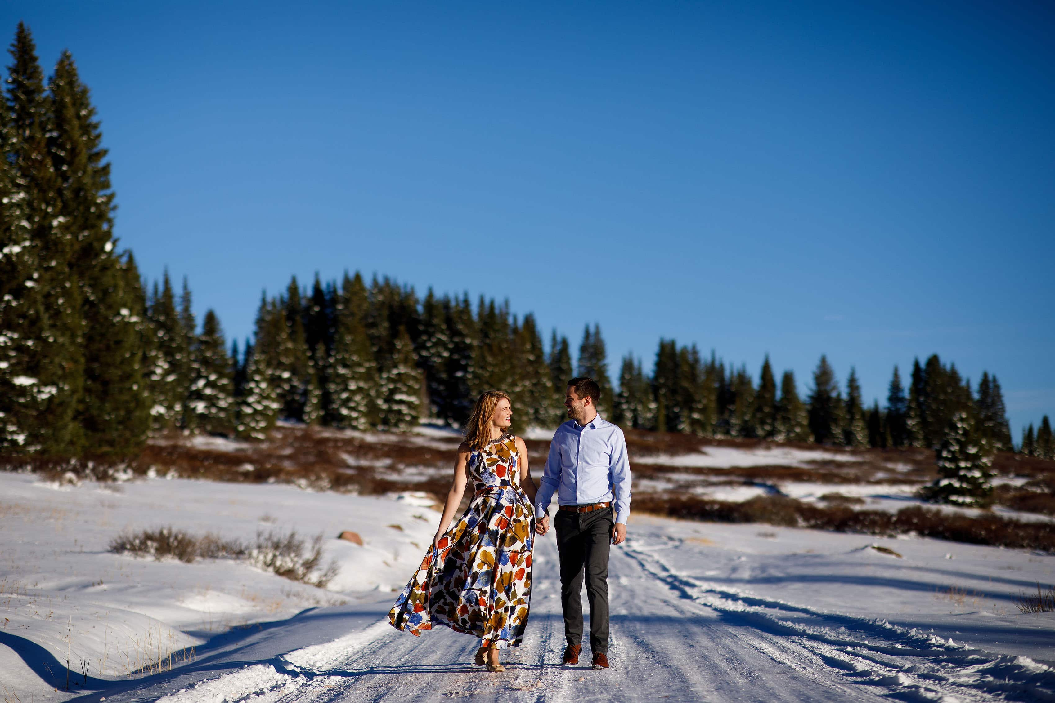 Julia and Micah walk together on the snowpacked road near Shrine Pass in Vail