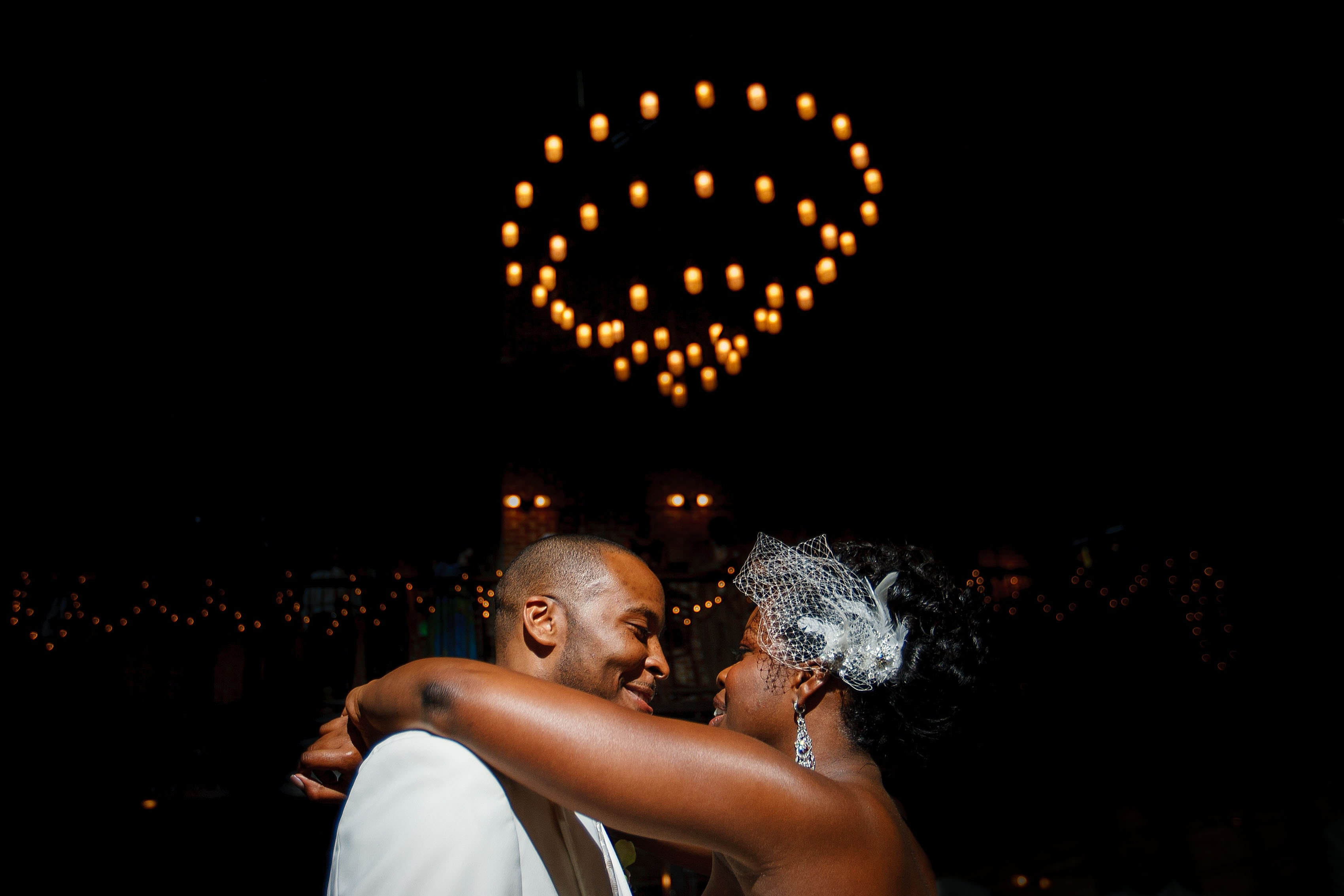 Alicia and Rick share a first dance their Mile High Station wedding in Denver, Colorado