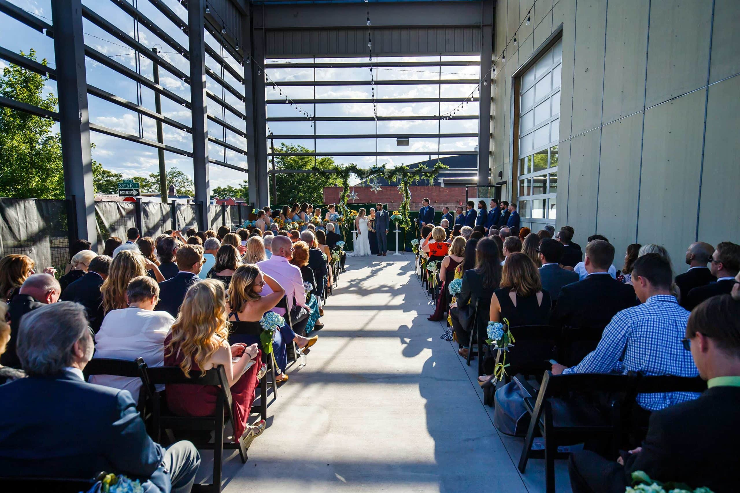 Coza and Joel's Space Gallery wedding ceremony on the patio in Denver