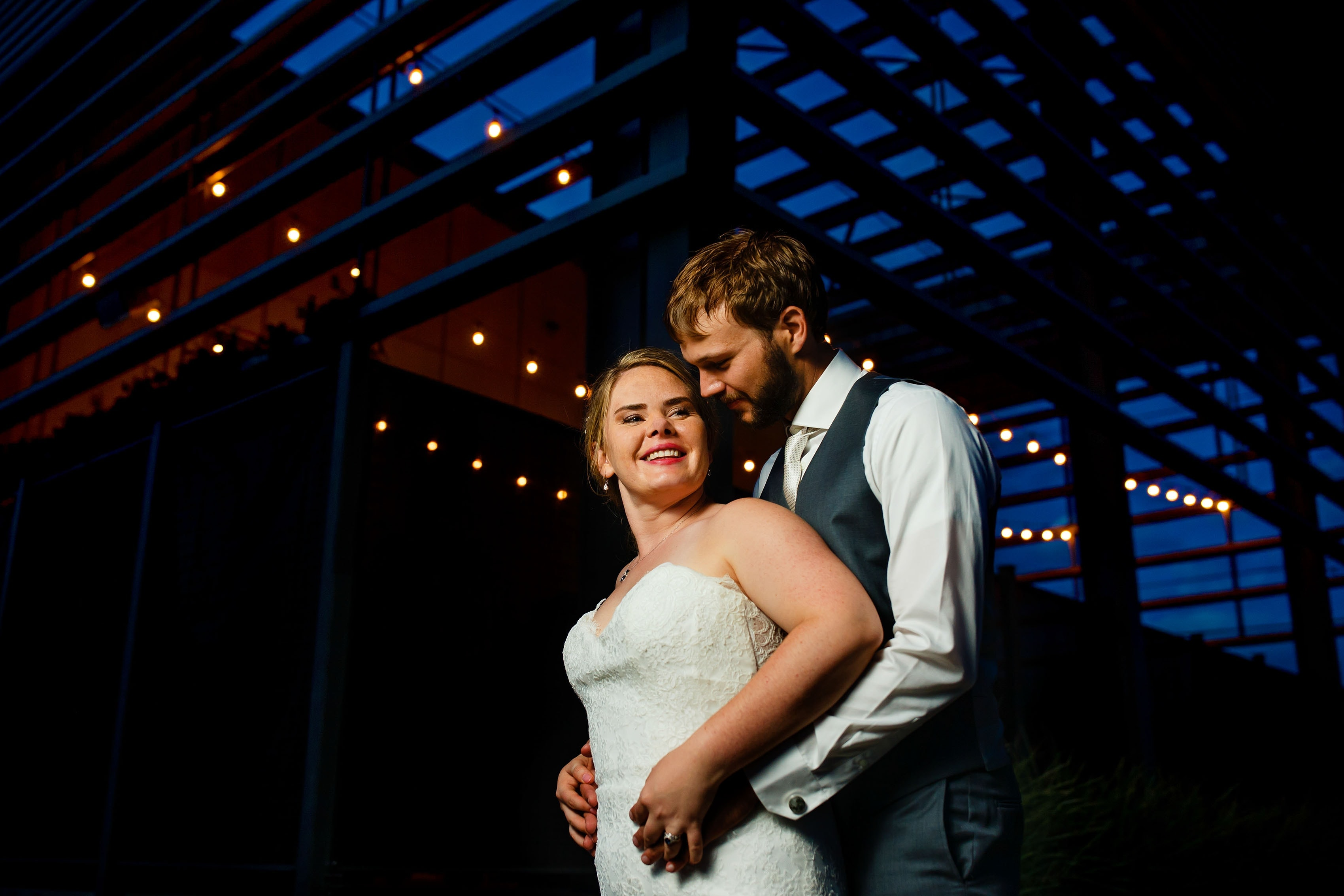 Bride and groom pose outside during their Space Gallery Wedding