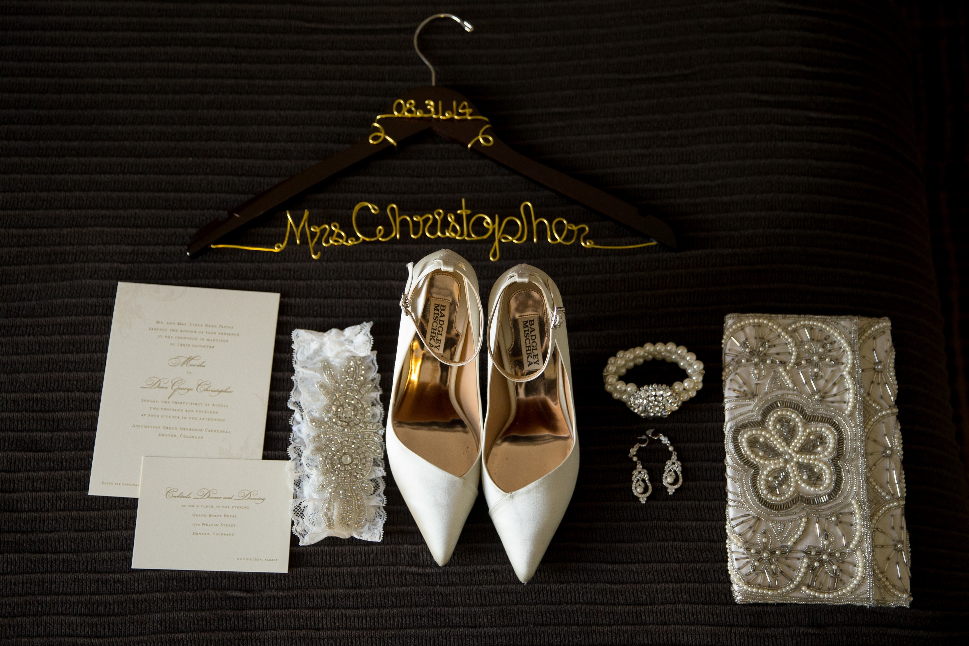 Bridal accessories are laid out on the bed