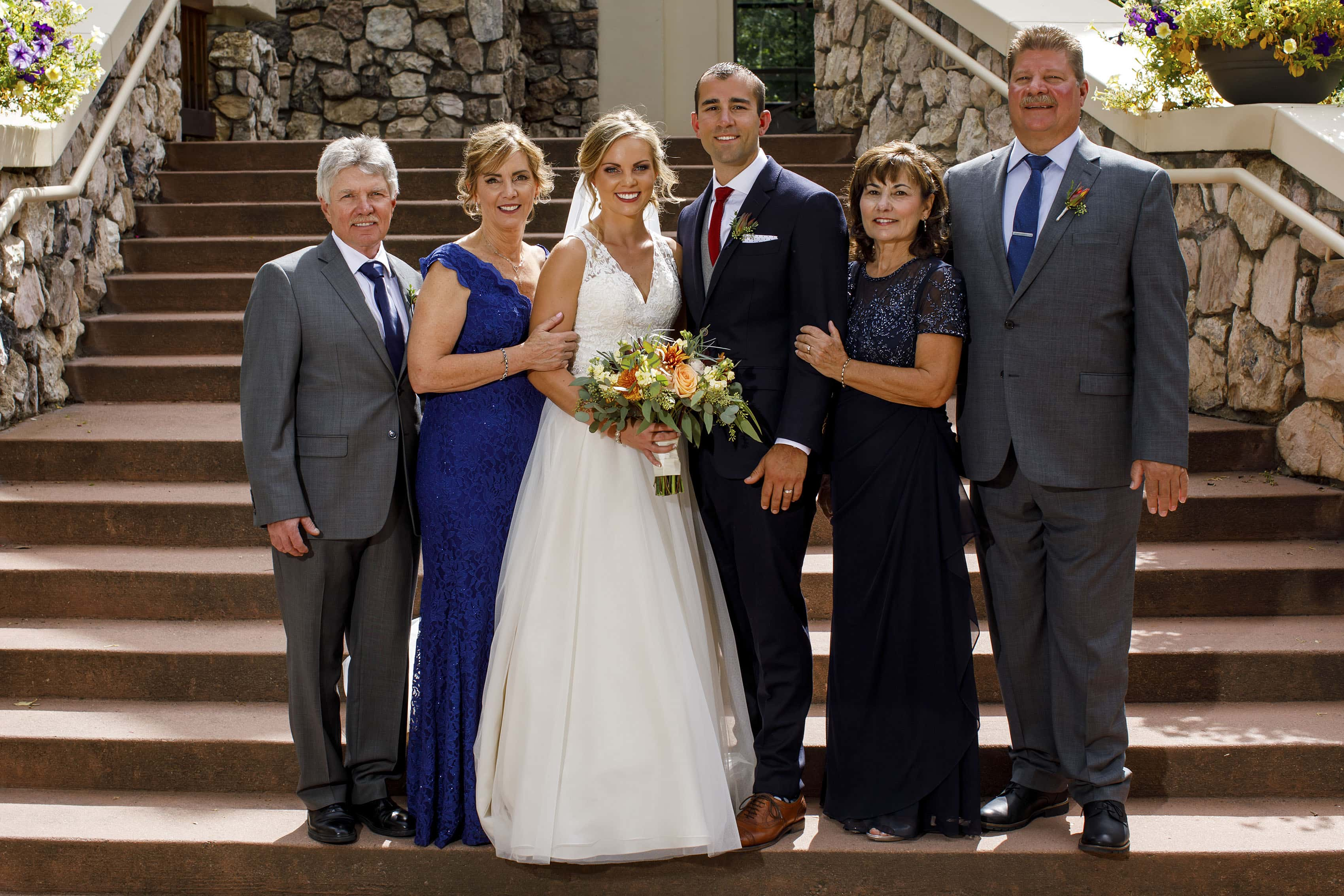 Newlyweds pose with their parents after their wedding ceremony at Beaver Creek Chapel