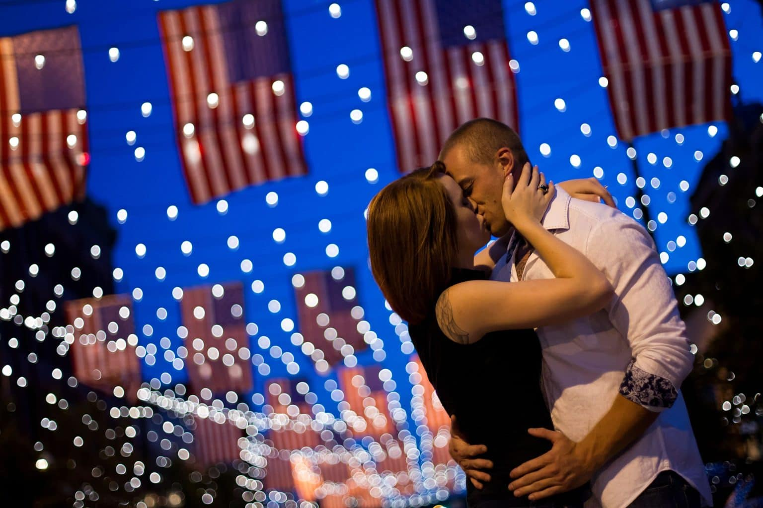Couple kisses in Larimer Square during their engagement session in Downtown Denver
