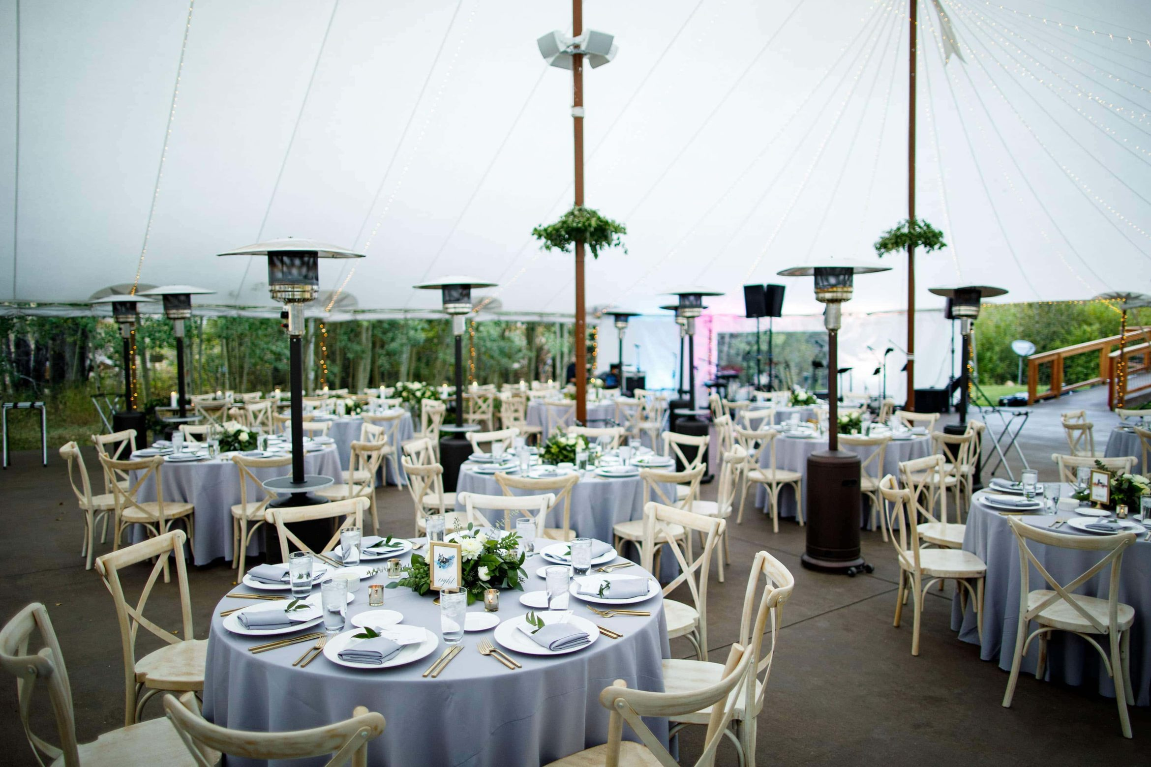 Table setup in the tent for a wedding at Blackstone Rivers Ranch