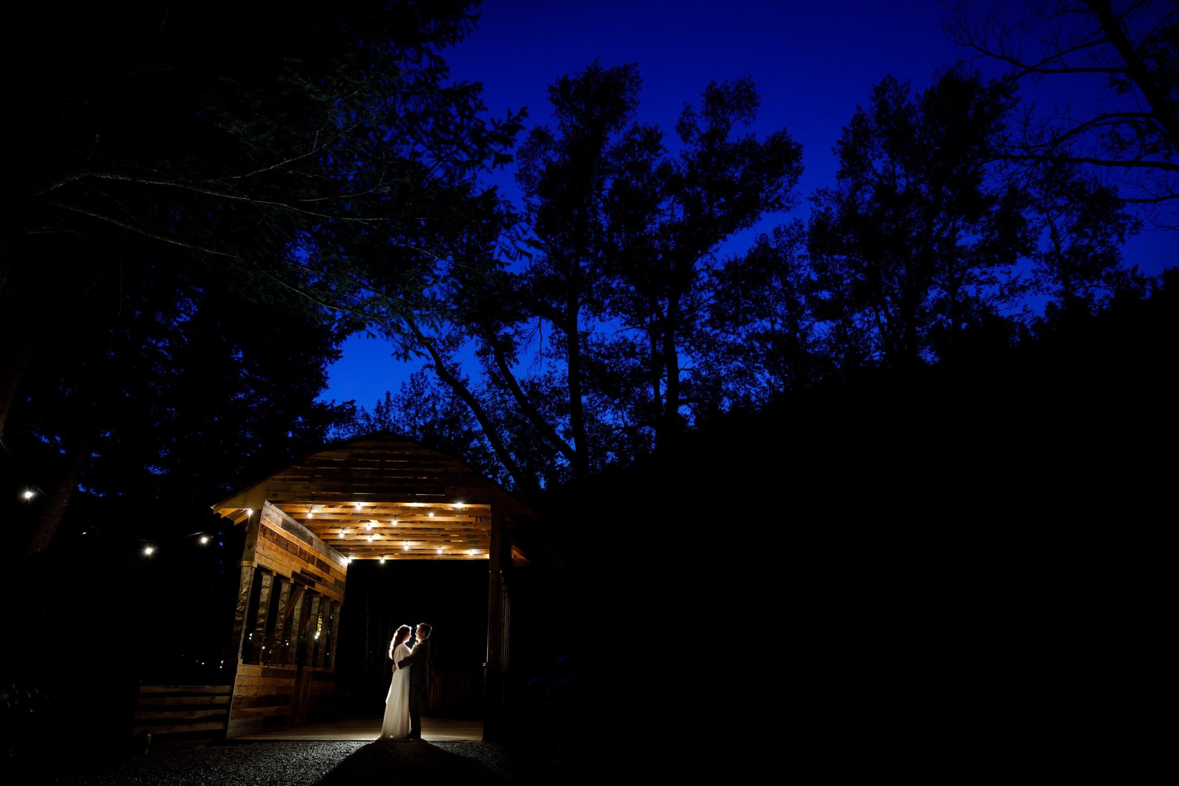 Twilight portrait of the bride and groom at Blackstone Rivers Ranch