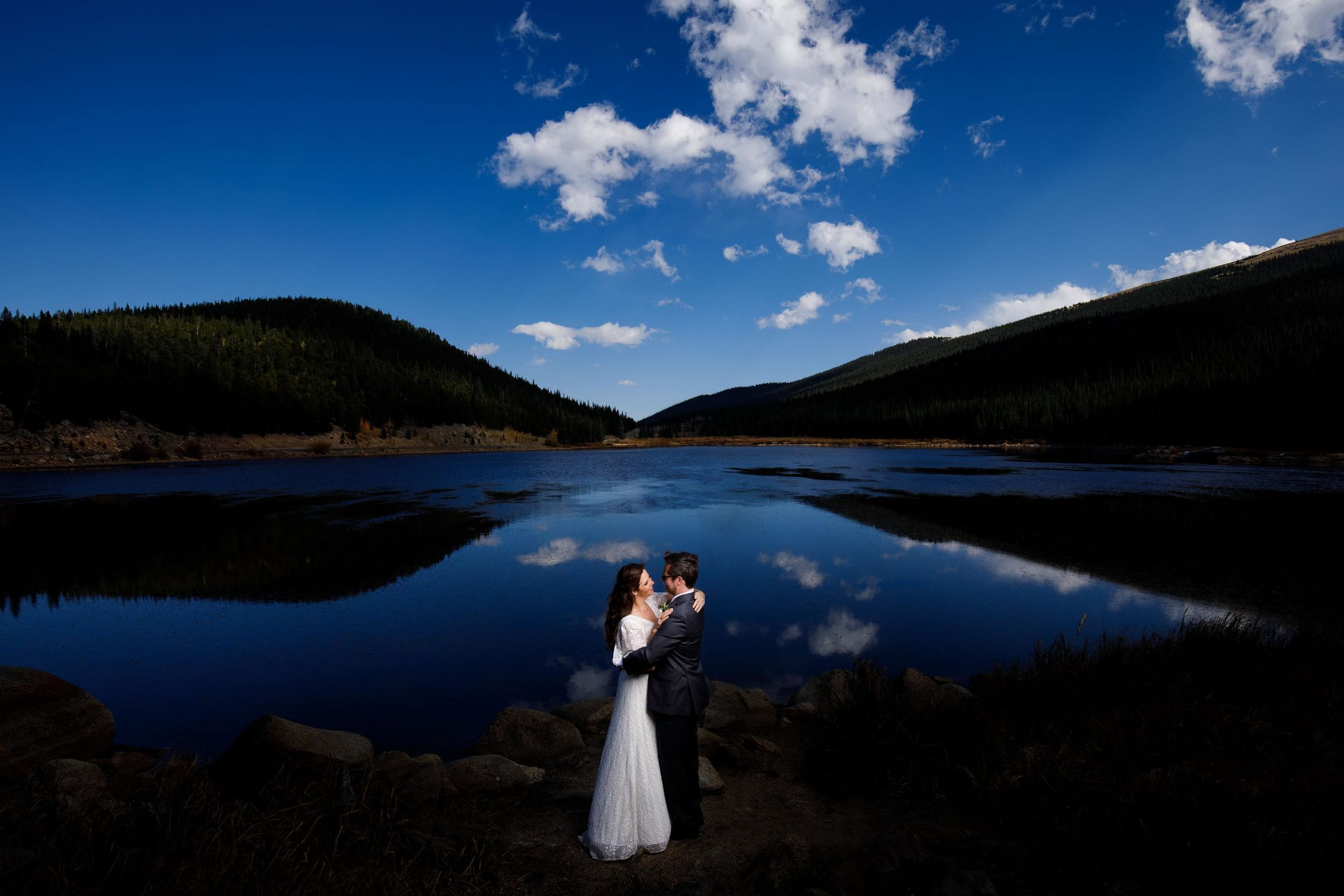 Bride and Groom pose for a portrait at Echo Lake near Blackstone Rivers Ranch