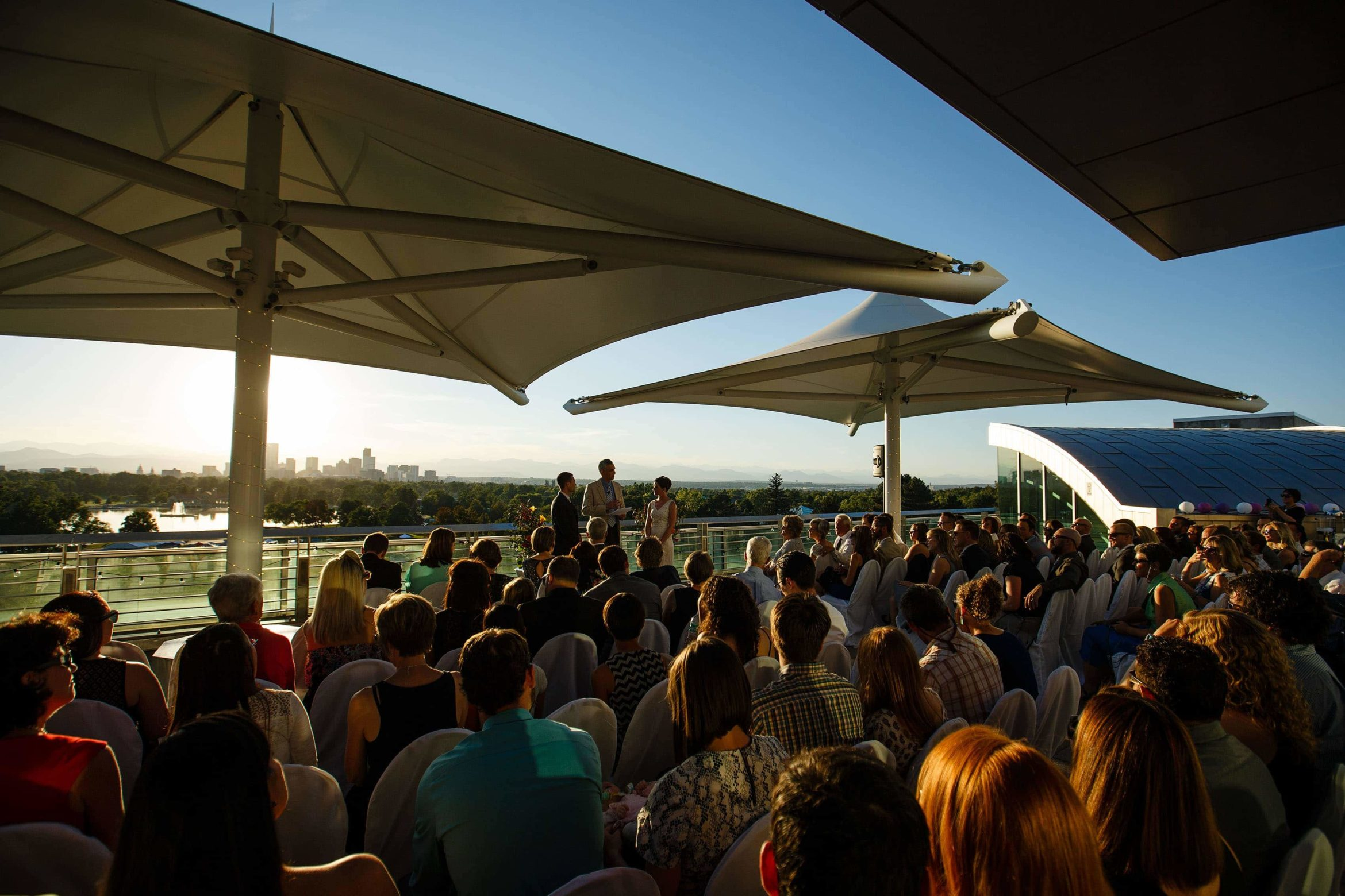 Denver Museum of Nature and Science rooftop wedding ceremony at sunset