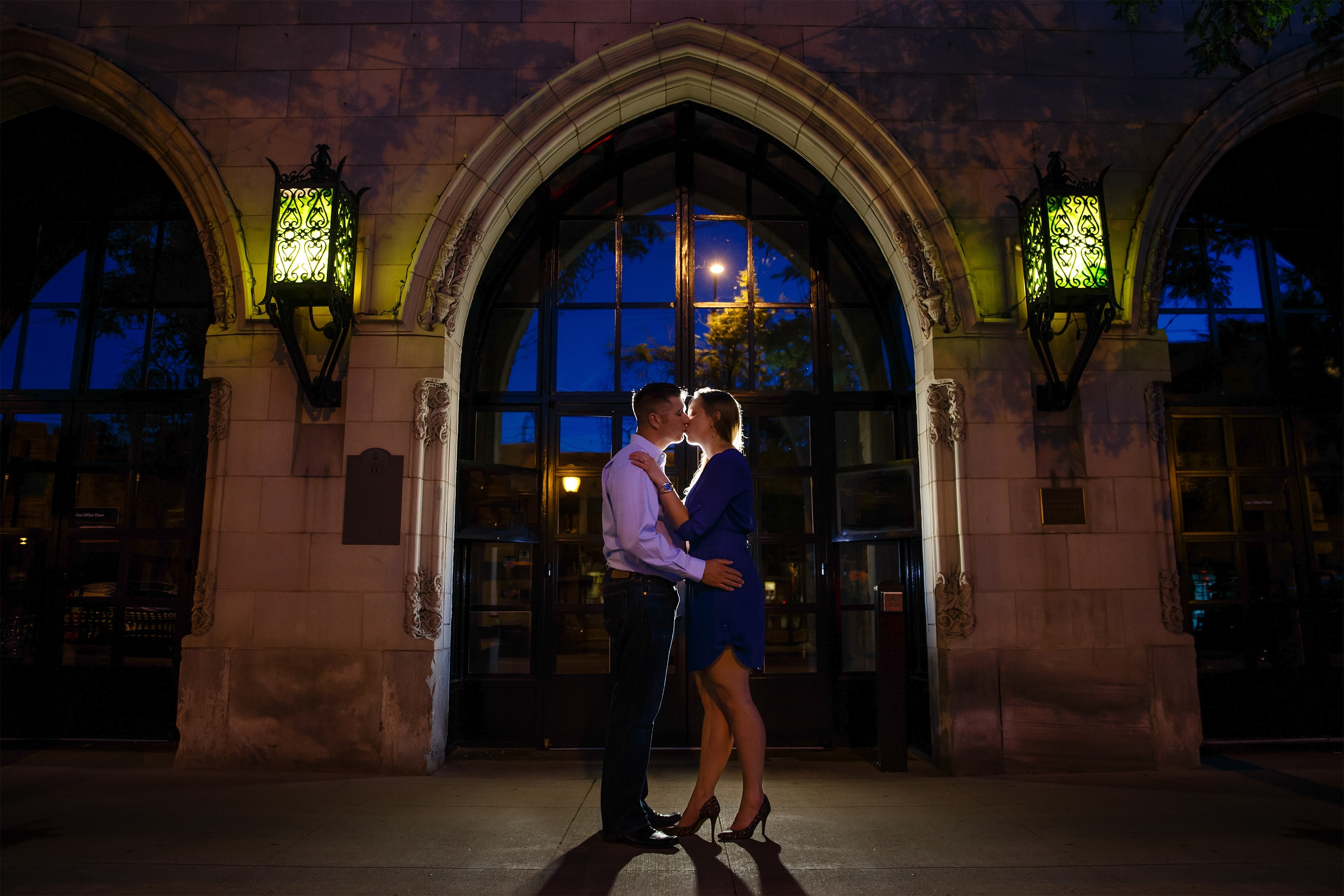 A couple kisses during their downtown Littleton engagement photos