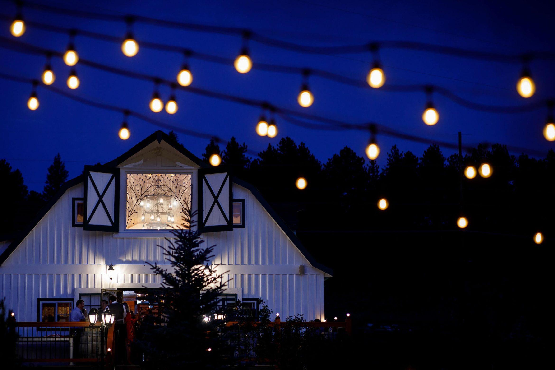 The Barn at Deer Creek Valley Ranch wedding venue at twilight