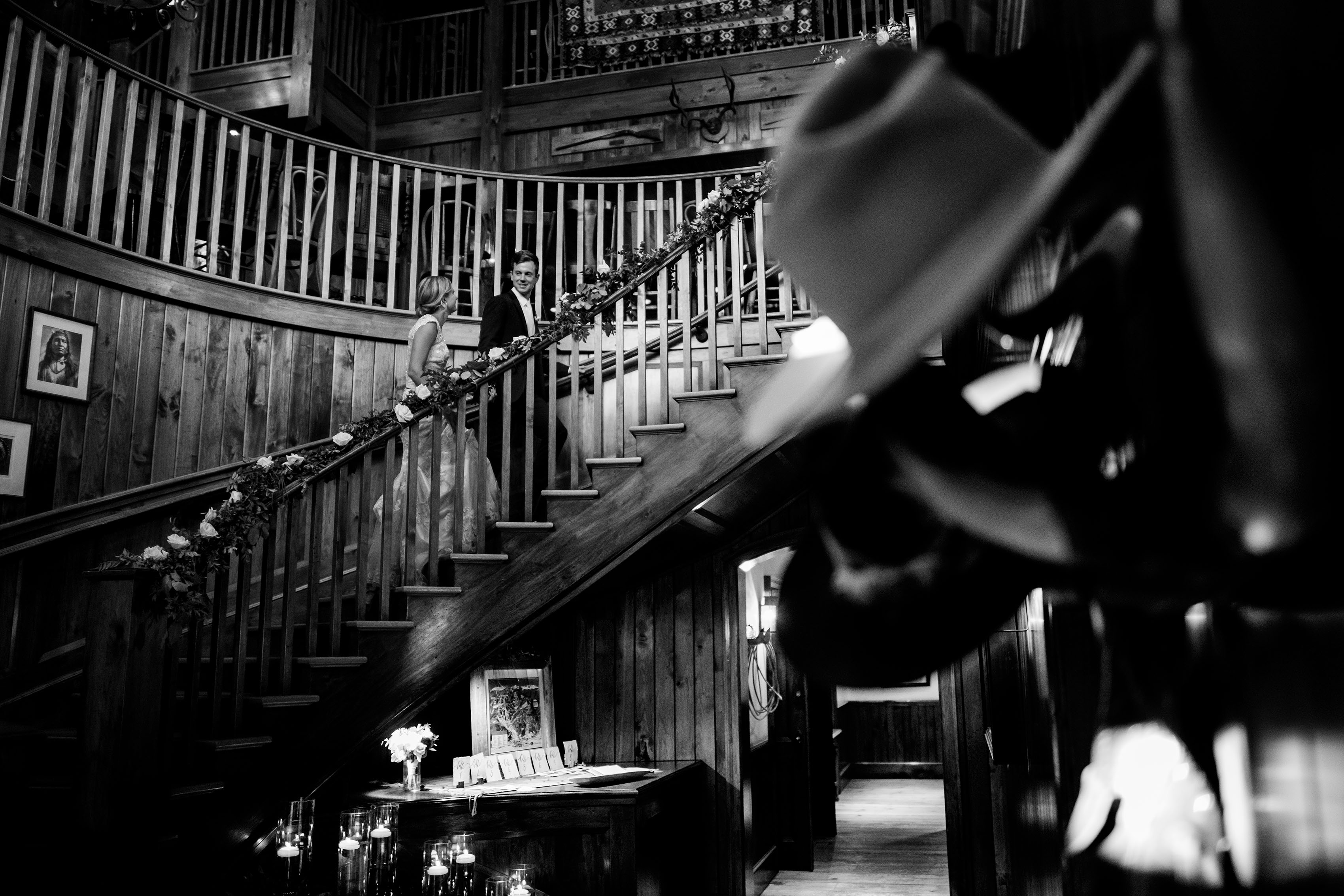 The newlyweds climb the spiral staircase at Saddleridge