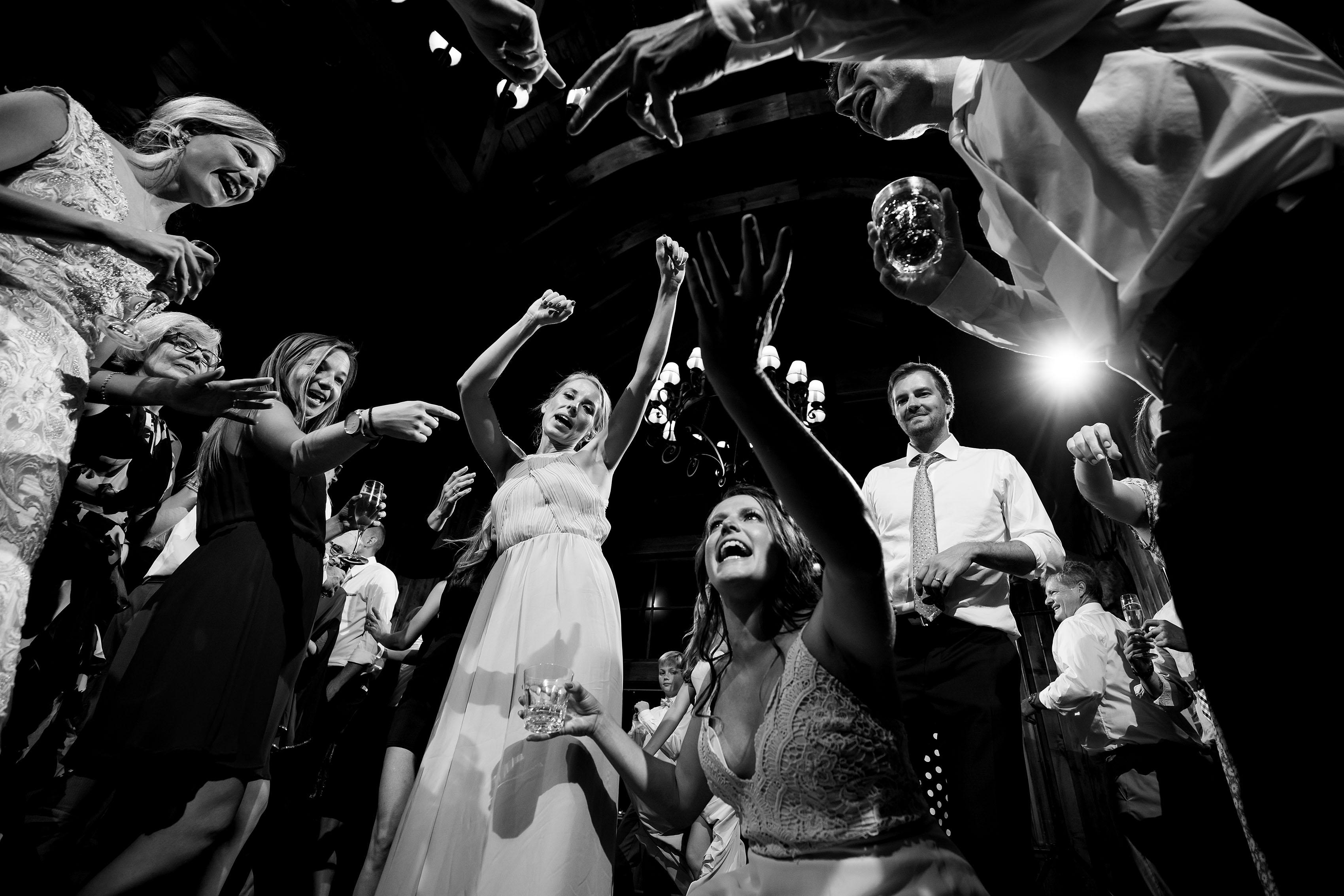 Guests dance during a wedding at Saddleridge in Beaver Creek