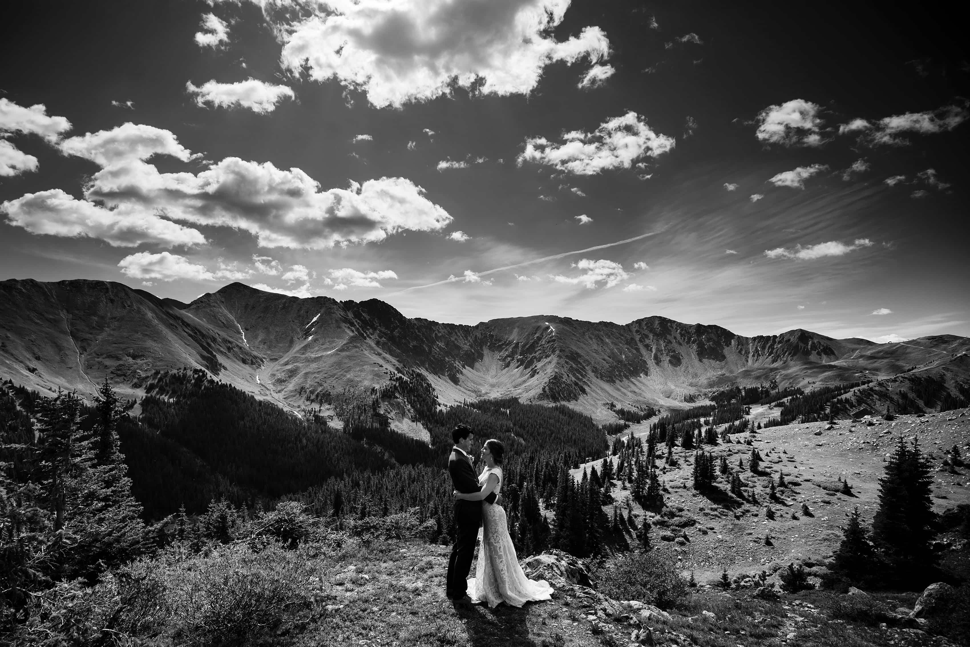 The bride and groom share a moment together atop Loveland Pass near Keystone, Colorado