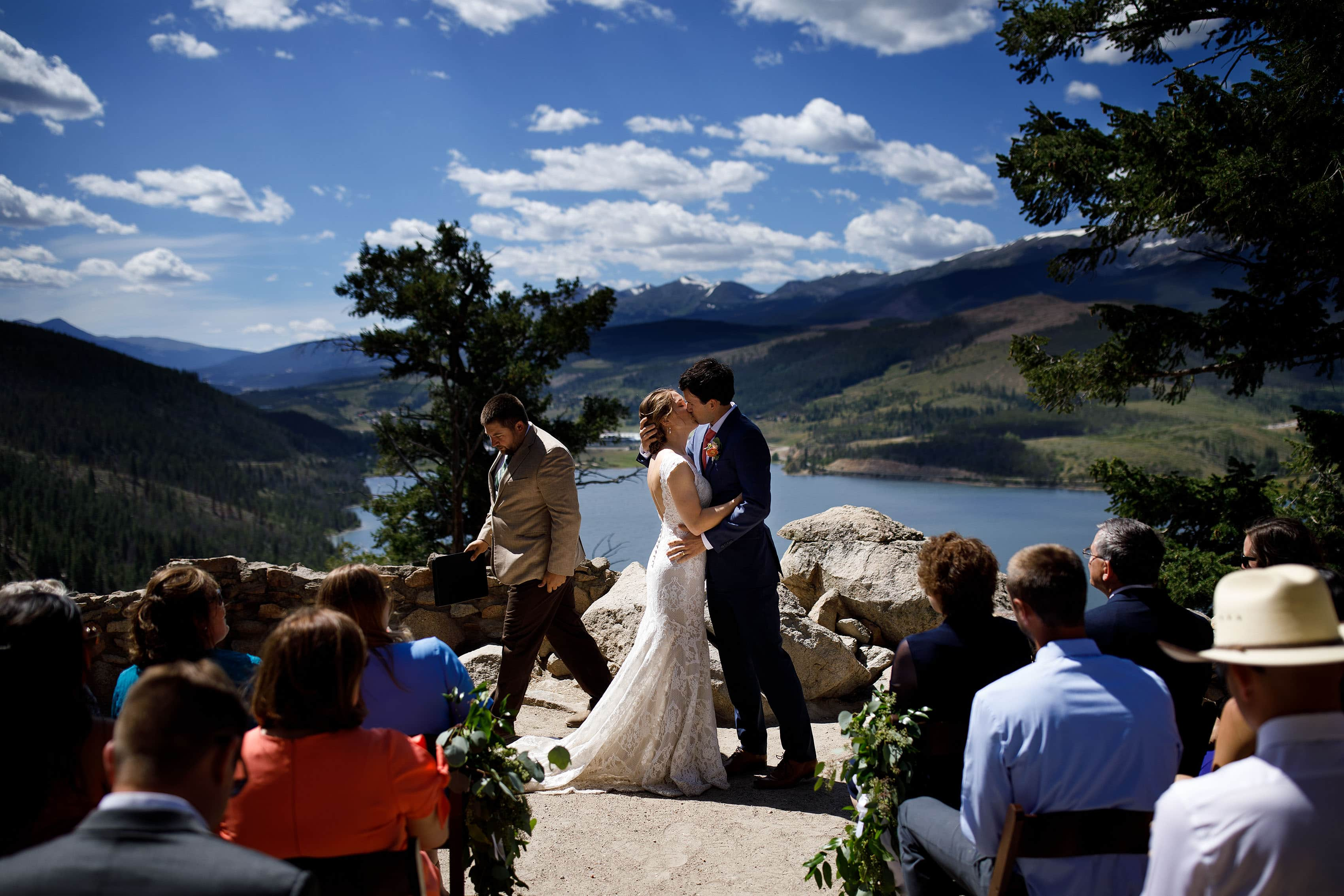 Kyle and Carissa share a kiss during their wedding at Sapphire Point