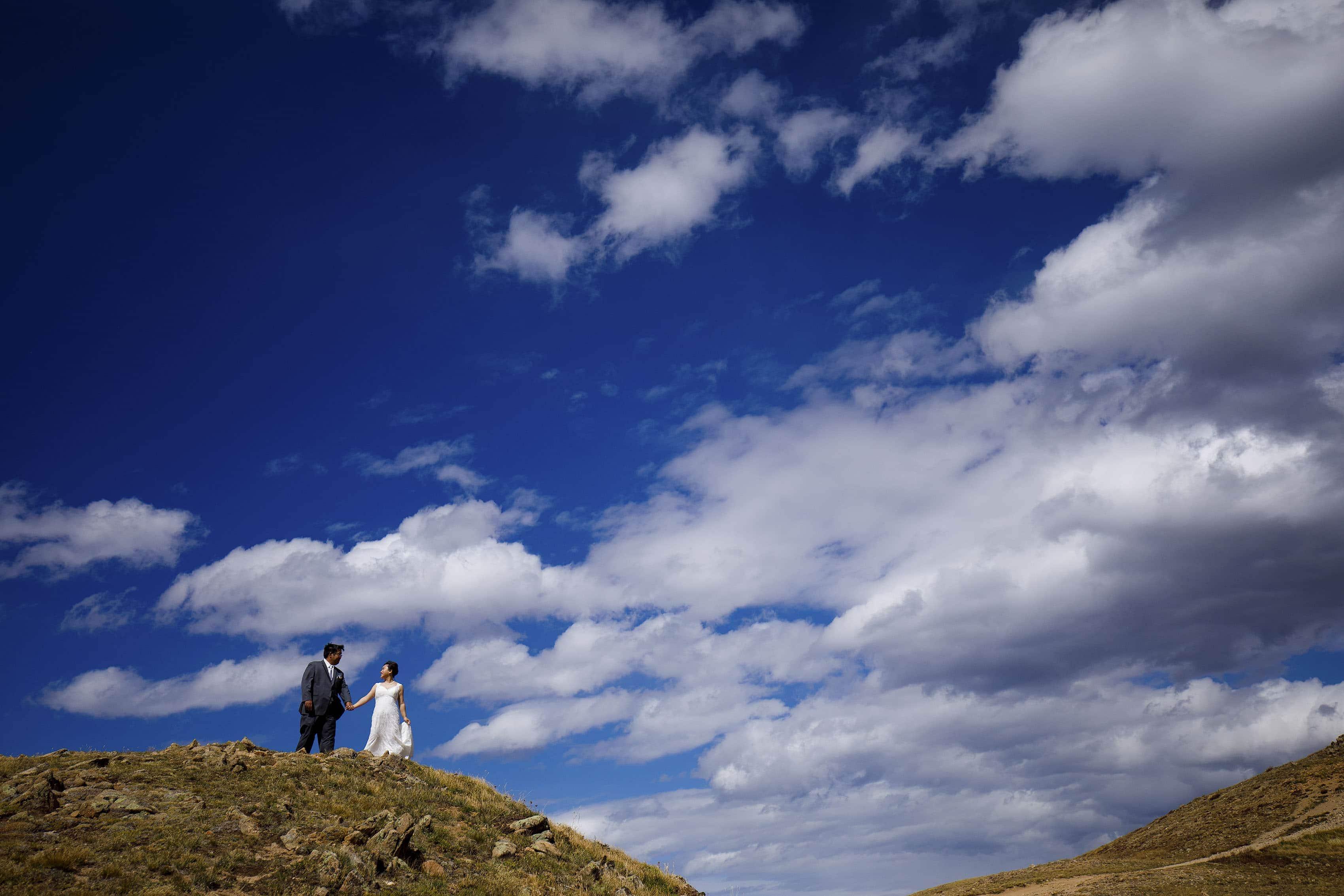 The newlyweds walk together on Loveland Pass