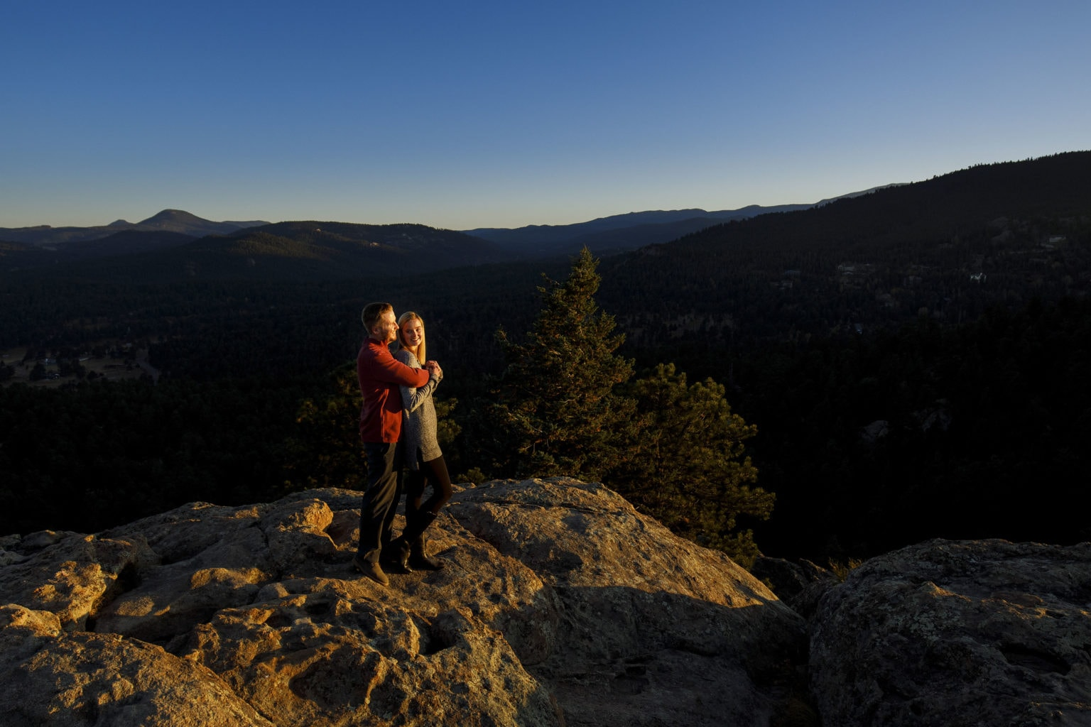 Stefan and Jennifer share a moment togather atop Brother's Lookout as the sun sets during their fall engagement session at Alderfer Three Sister's Park