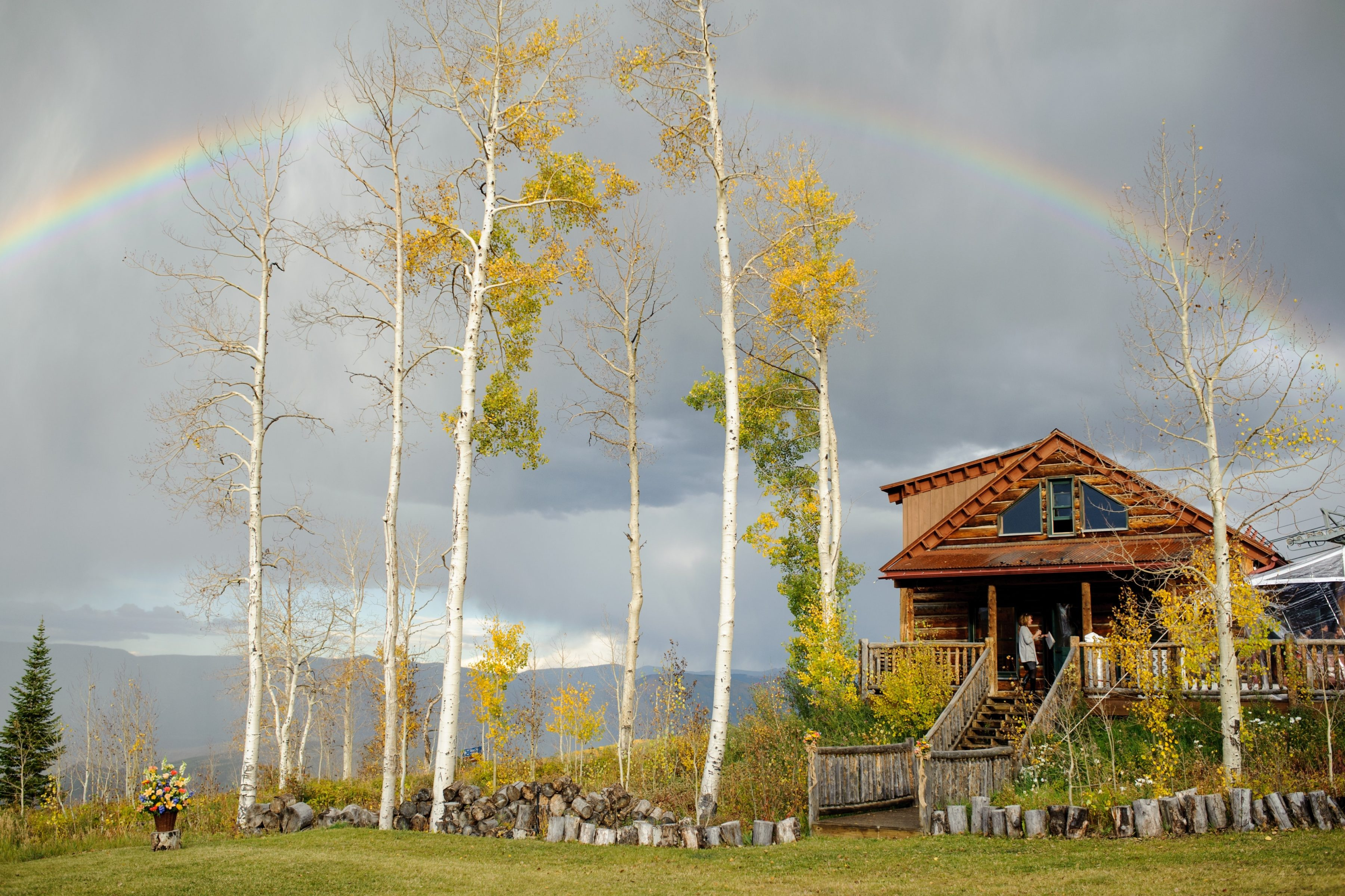 A rainbow over Lynn Britt Cabin on Snowmass Mountain