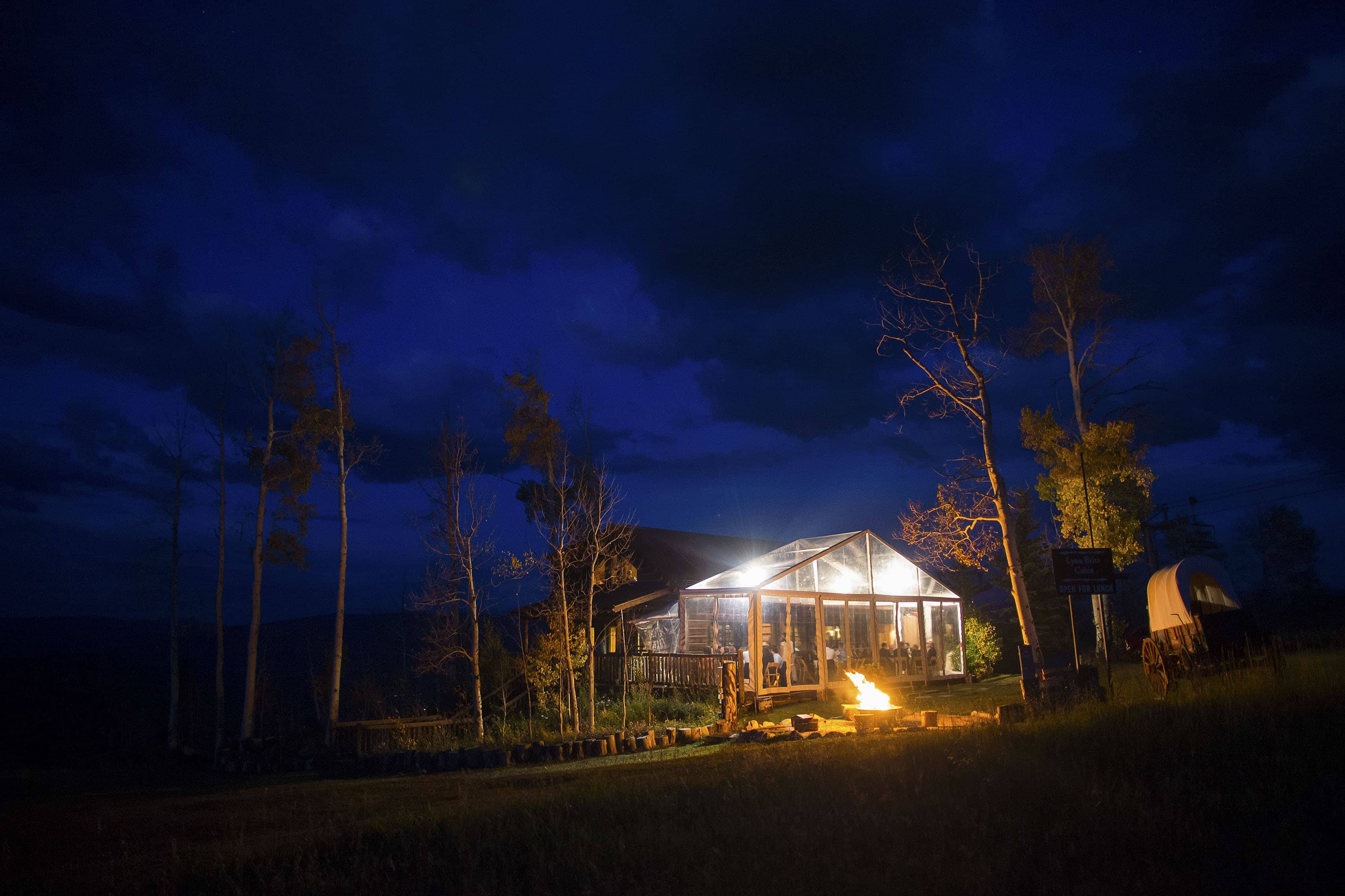 Lynn Britt Cabin at twilight during a wedding reception on Snowmass Mountain