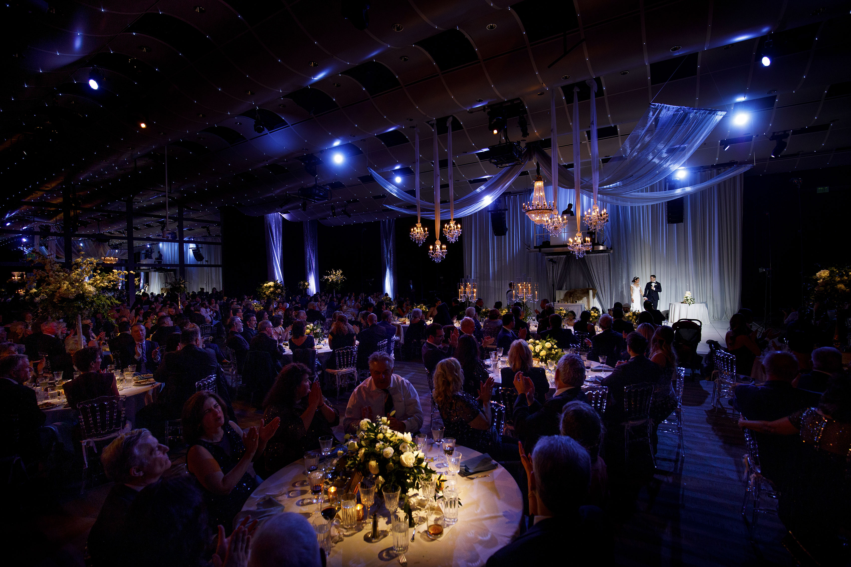 The bride and groom thank their guests during their greek wedding reception at the Seawell Ballroom in Denver