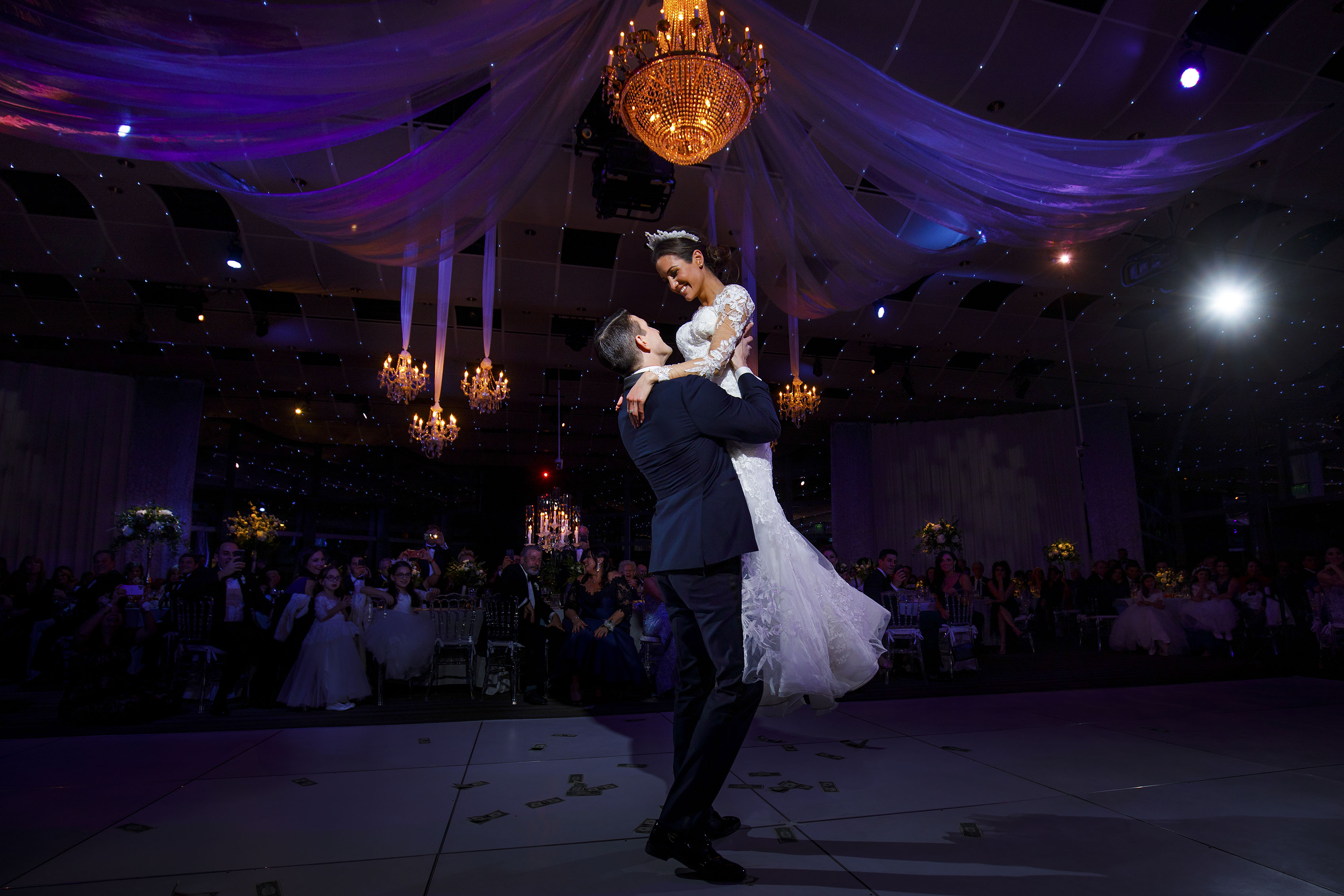 Ioanna and Alex share their first dance together during their Seawell Ballroom wedding reception at the Denver Center for The Performing Arts
