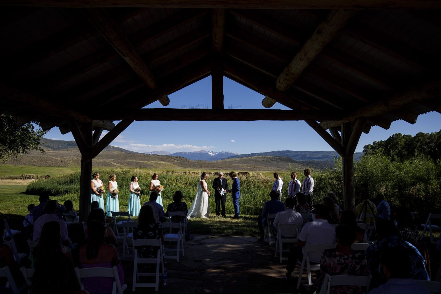 Ryan and Laura's wedding ceremony under the pavillion at 4 Eagle Ranch