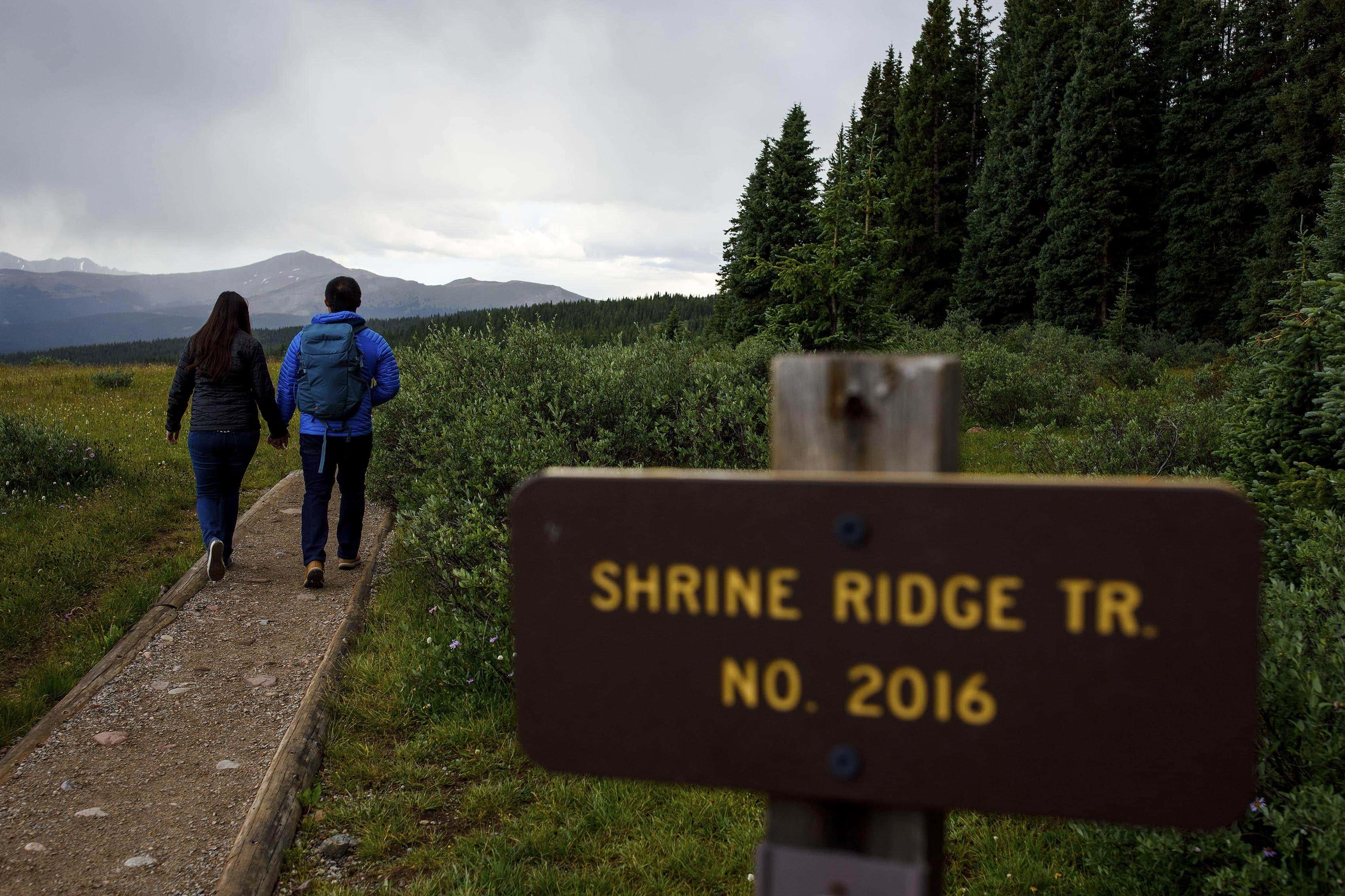 A couple walks along the Shrine Ridge Trail