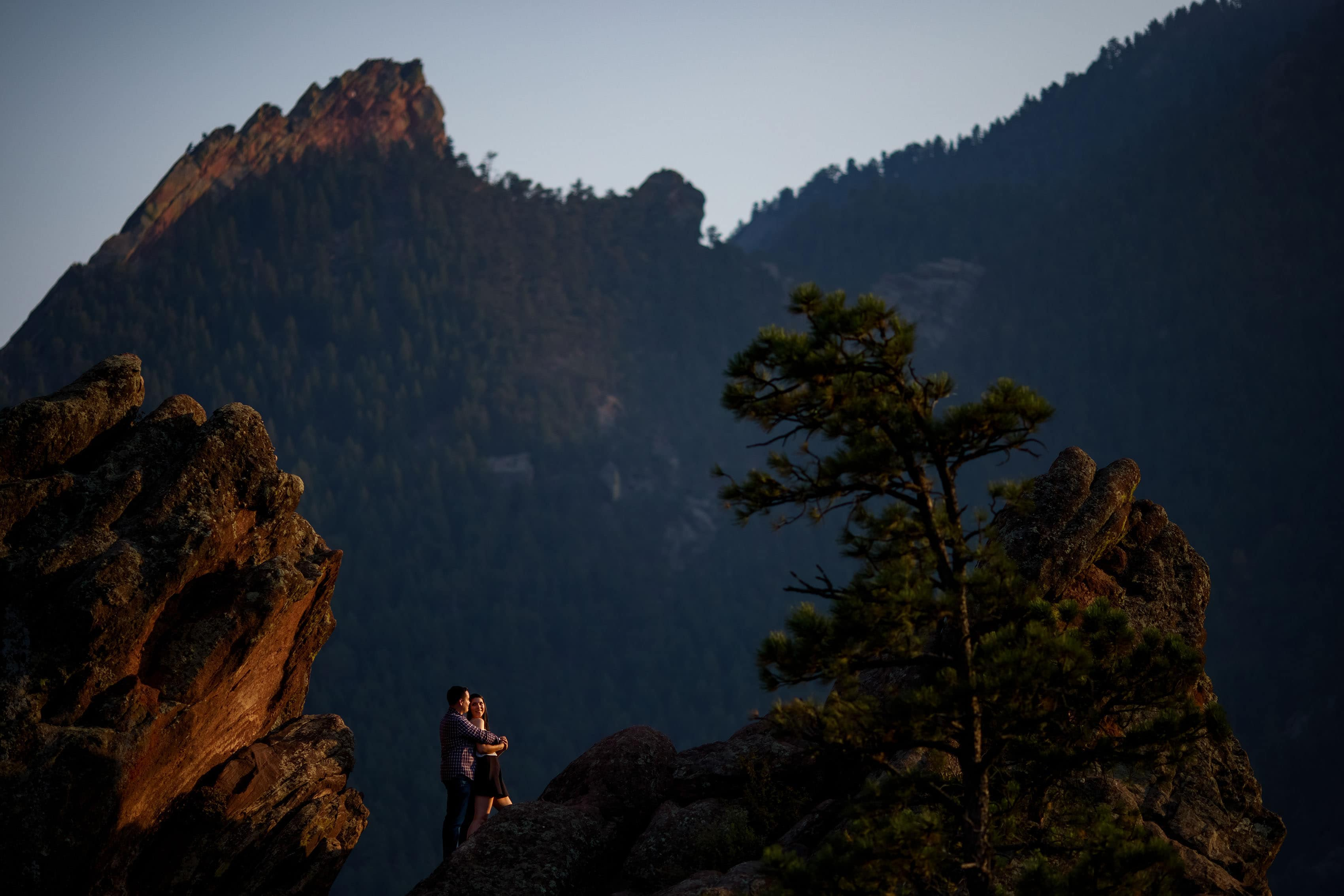 A couple poses together on Flagstaff Mountain during their Boulder engagement session
