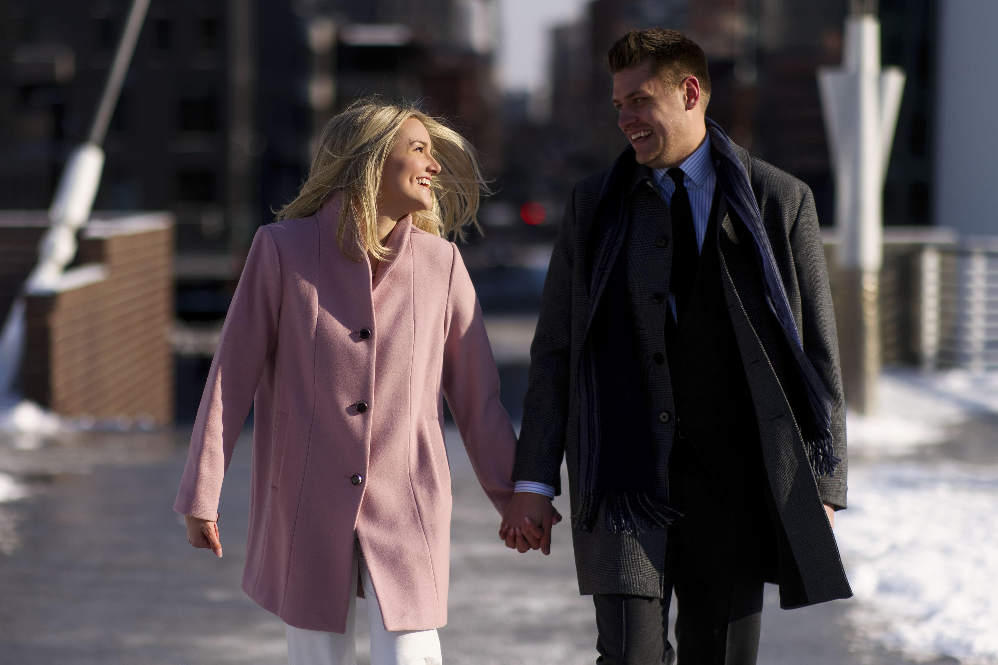 Kelly and Willy walk together after their valentines day proposal in downtown Denver