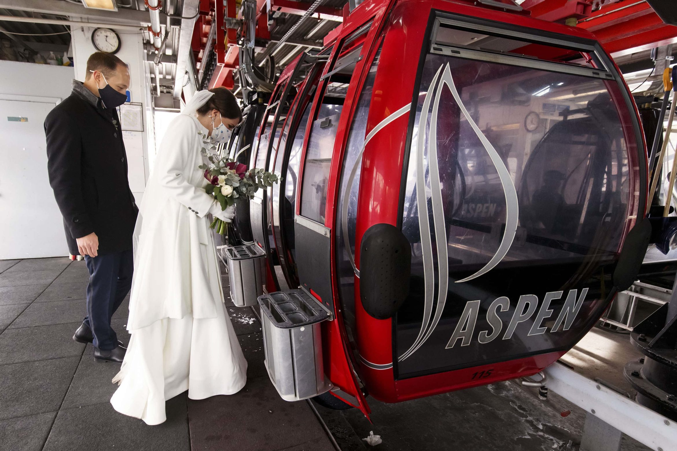 The bride and groom board the Silver Queen Gondola at Aspen Mountain on their wedding day