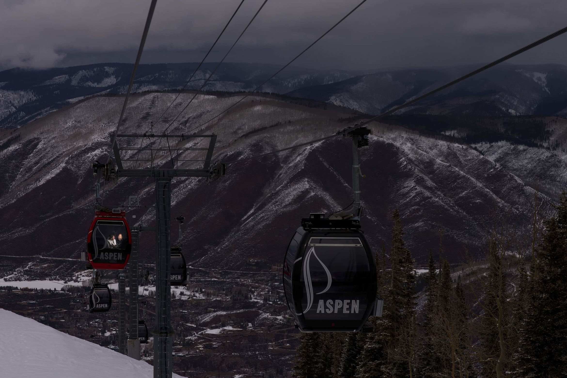 The bride and groom ride the Silver Queen Gondola during their winter micro wedding in Aspen