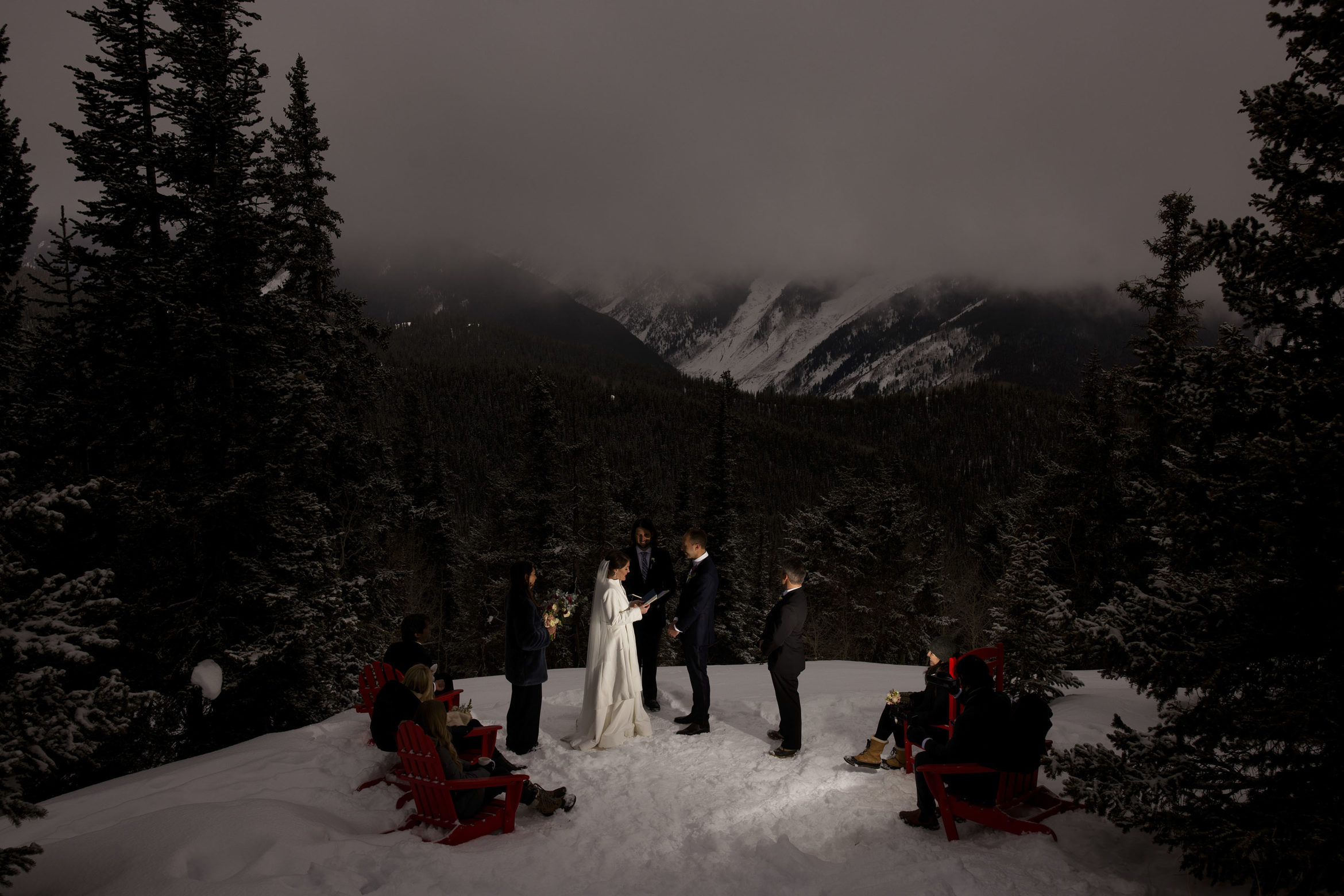 Olivia reads her vows on the Aspen wedding deck as the fog rolls in during their micro wedding