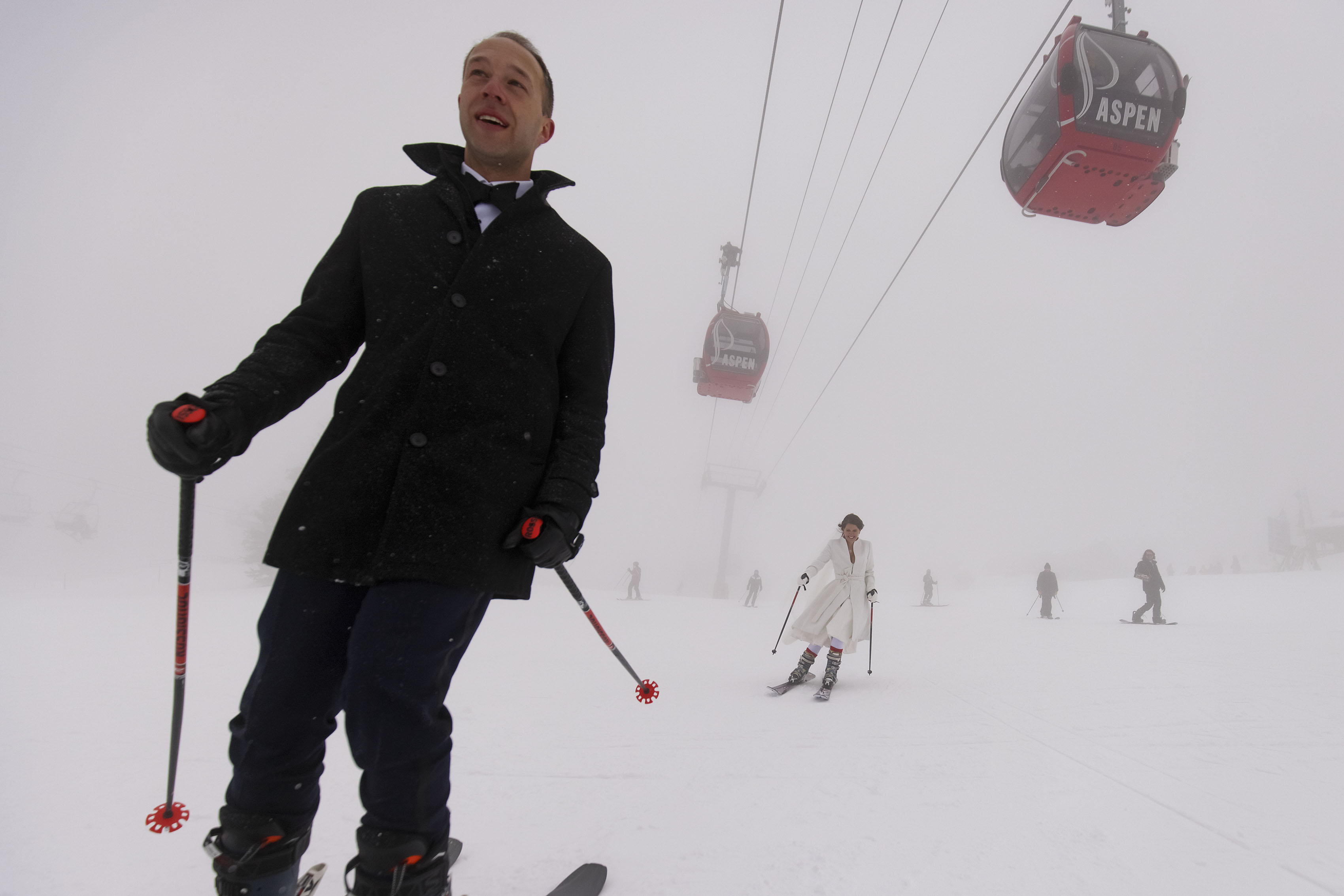 The newlyweds ski down Aspen mountain following their winter micro wedding ceremony