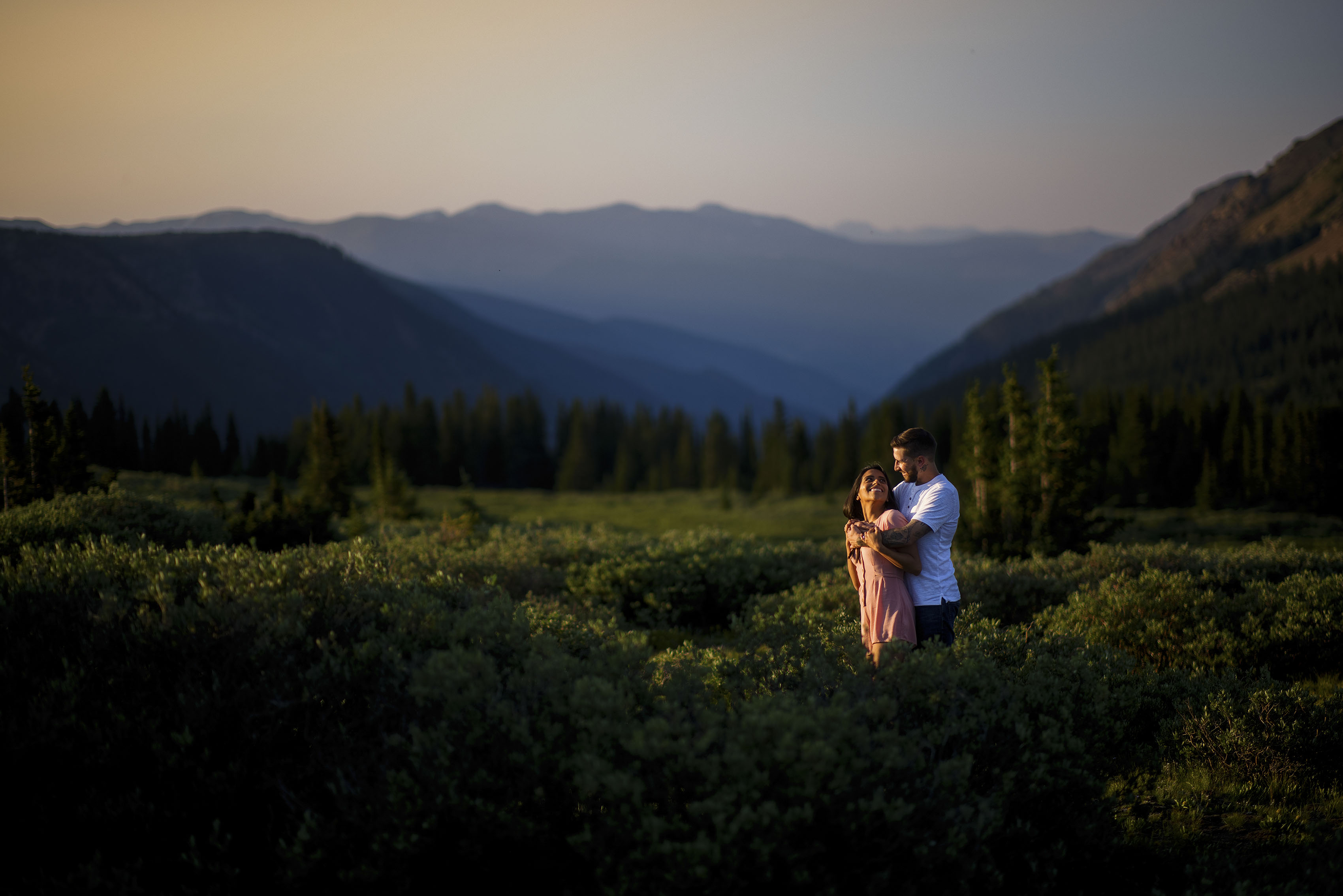 A newly engaged couple share a moment on Guanella Pass