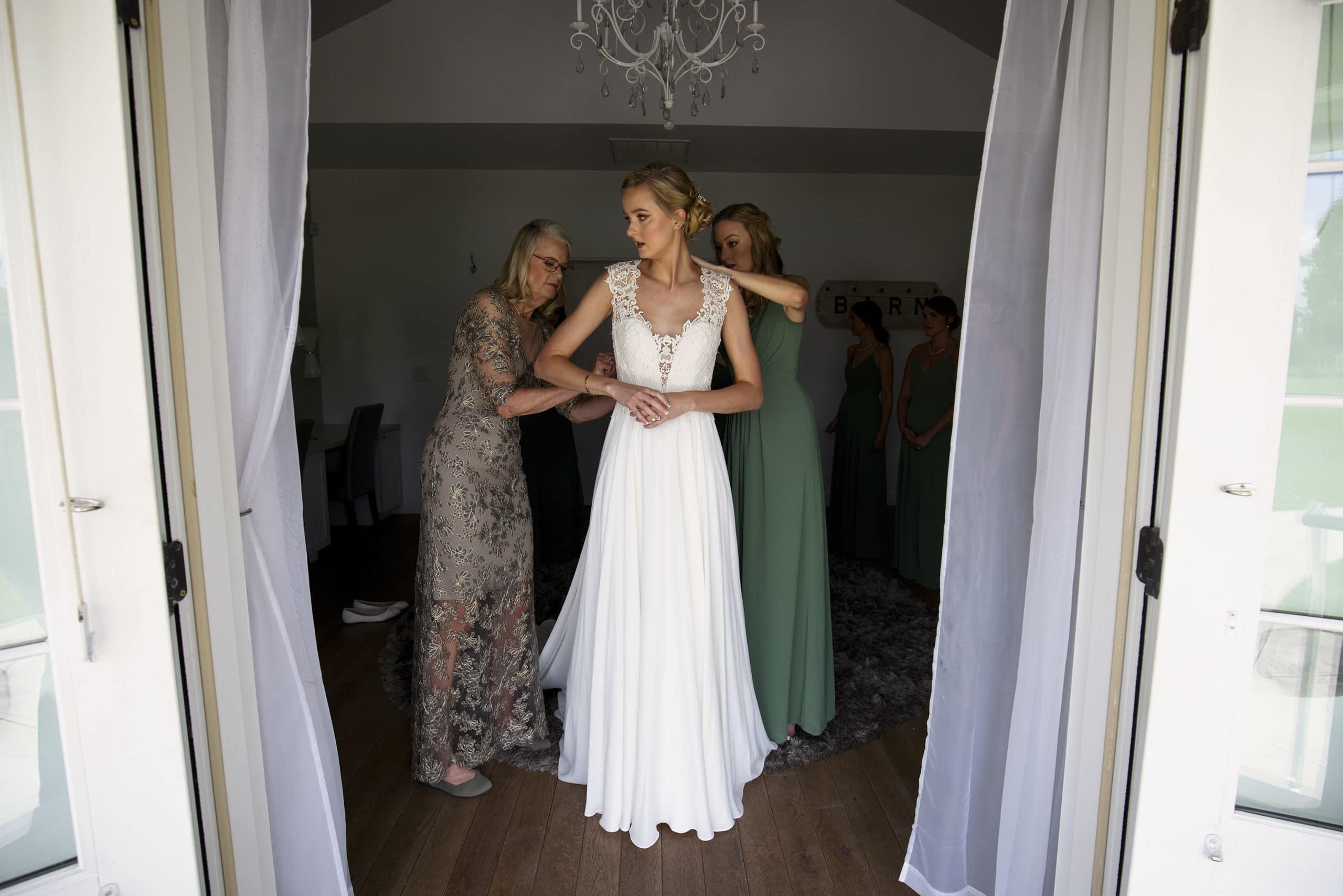 Jennfer gets into her wedding dress